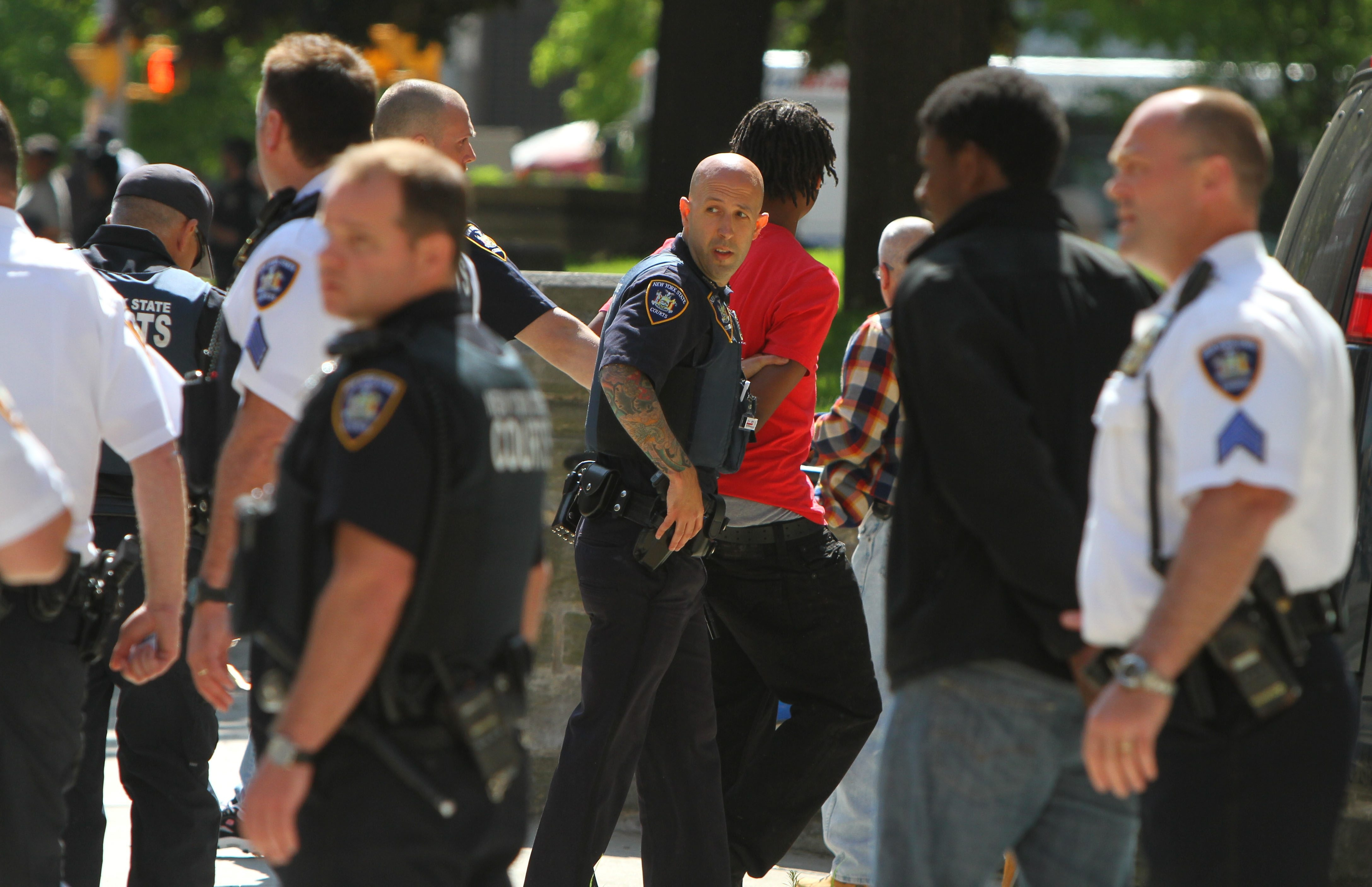 Buffalo police have several people in handcuffs outside Erie County Courthouse Wednesday after a fight broke out between  friends and family of two teens who had just received life terms for the murder of a Buffalo cabbie. Ten people were arrested outside the court.
