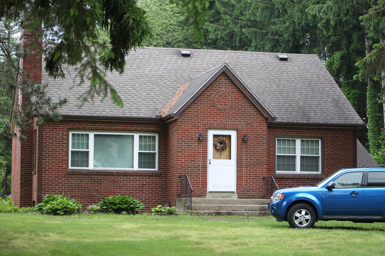 This Alden house was the scene of an apparent murder-suicide that left Sherry Koblich Zukowski, pictured below, dead.