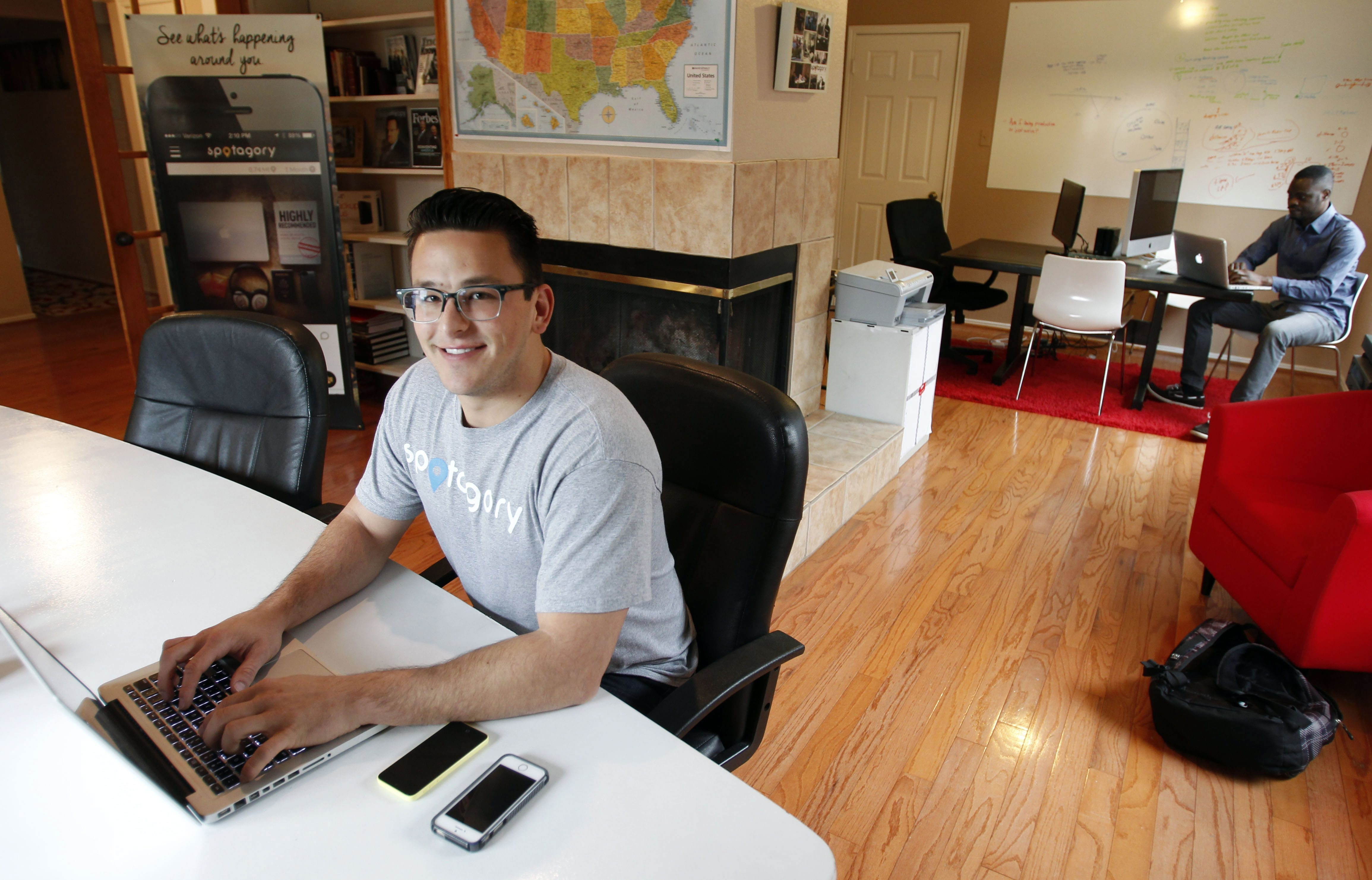 Kaleb Bryan, shown at home in Coppell, Texas, is the co-founder and CEO of Spotagory, a mobile photo-sharing app.