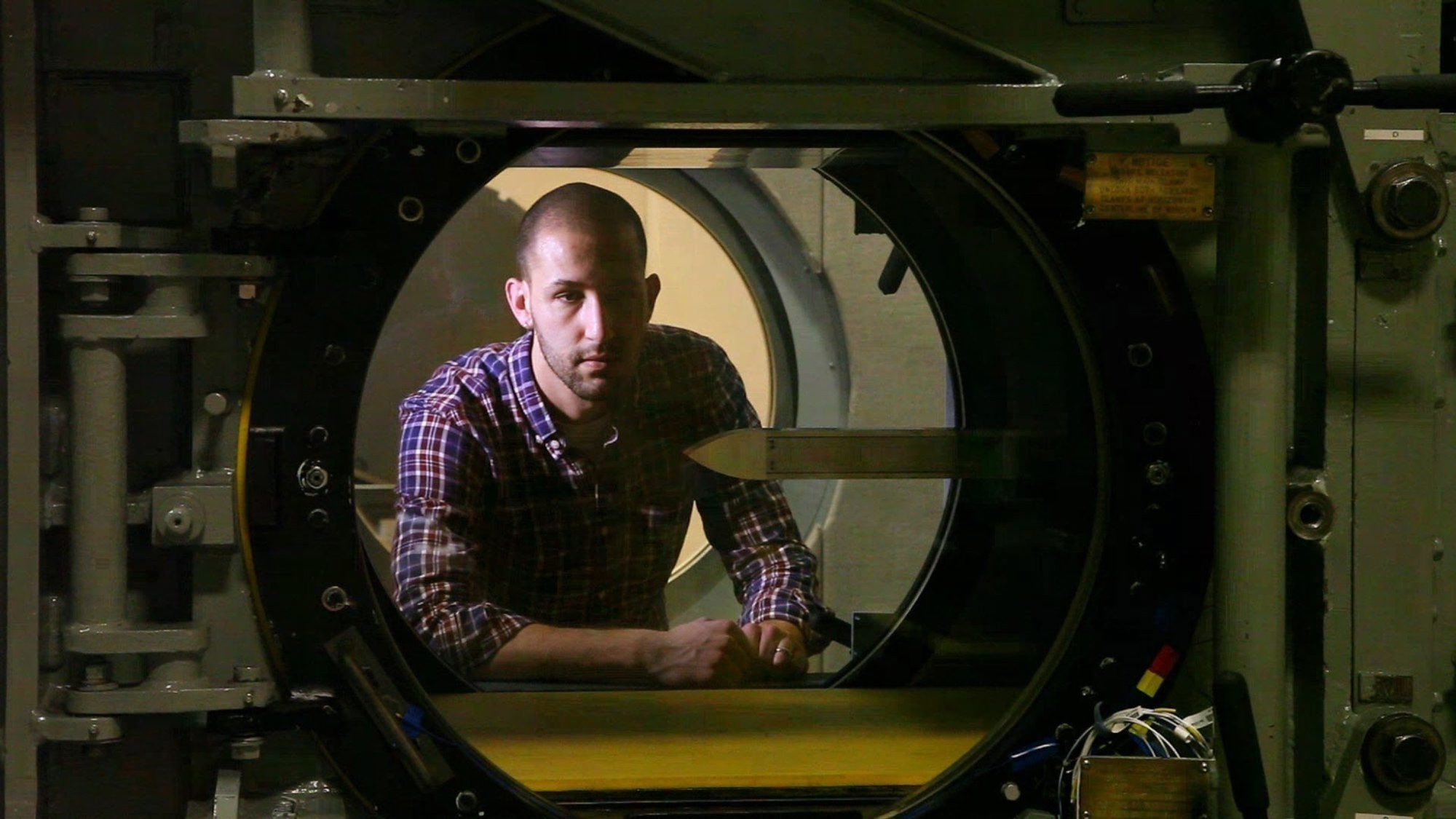 Aerospace engineer Benjamin Hagen looks inside of the Air Force Research Laboratory's trisonic wind tunnel, where he is studying the fluid dynamics of transonic air flow at Wright-Patterson Air Force Base in Dayton, Ohio. Due to a large number of retirements over the last few years, the research lab is looking to hire about 300 new scientists.