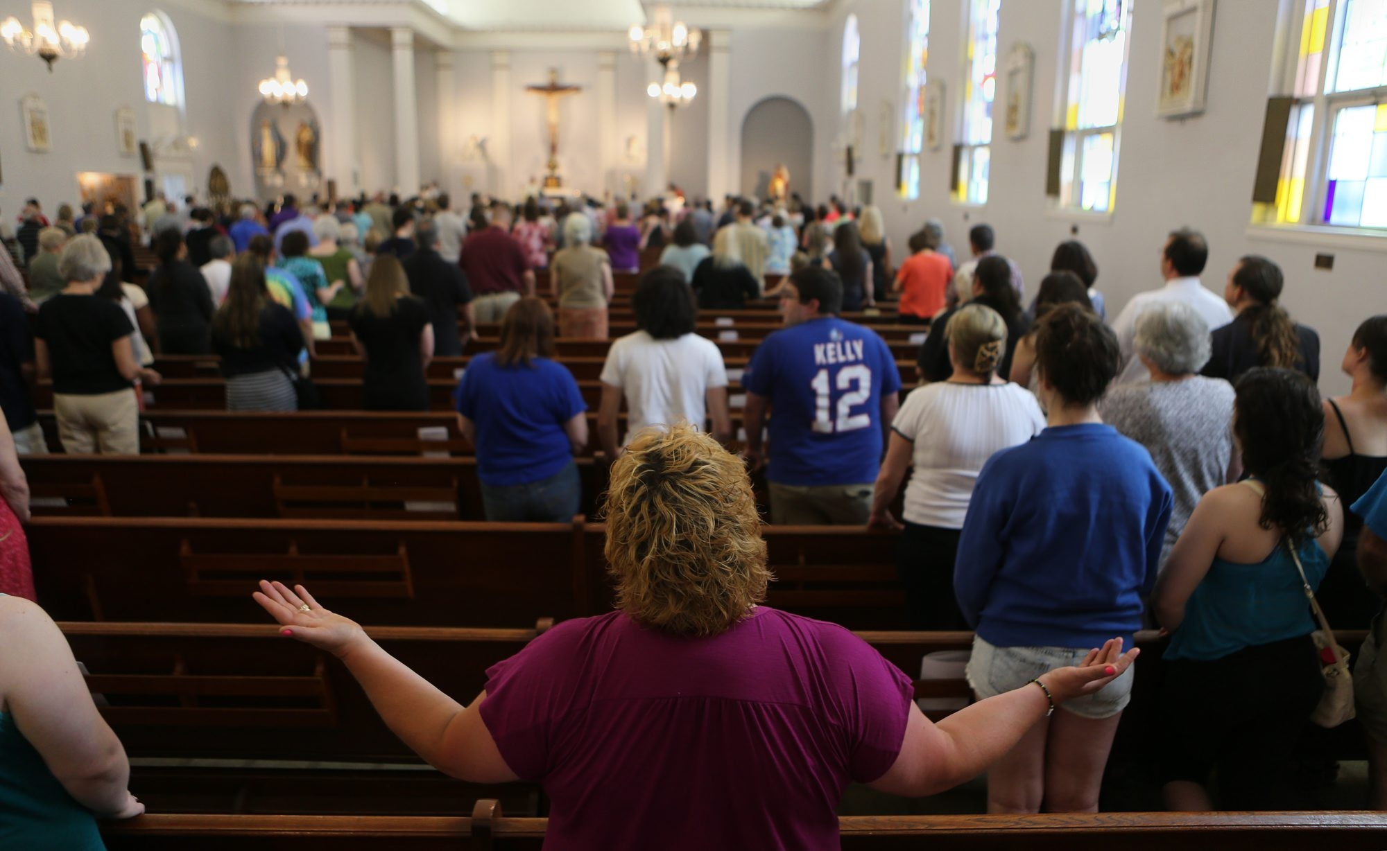 A Mass Mob, the fourth in Buffalo, helped fill the pews Sunday at historic All Saints Catholic Church in Riverside.