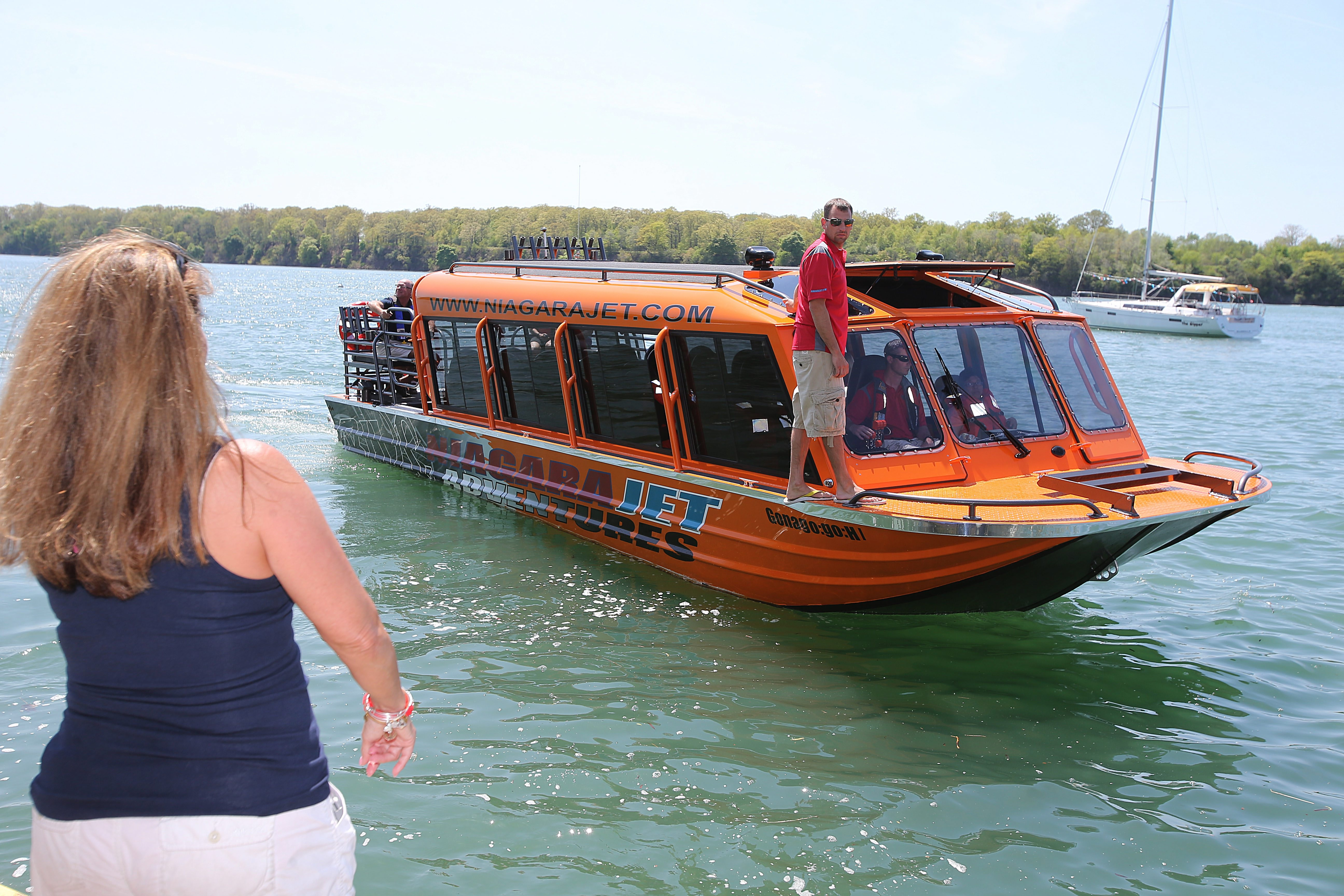 """Builder Chris Bohnenkamp of Boise, Idaho, calls his new boat """"the toughest whitewater boat in the industry"""" with three engines and a hull designed to withstand the pounding of the Niagara River."""