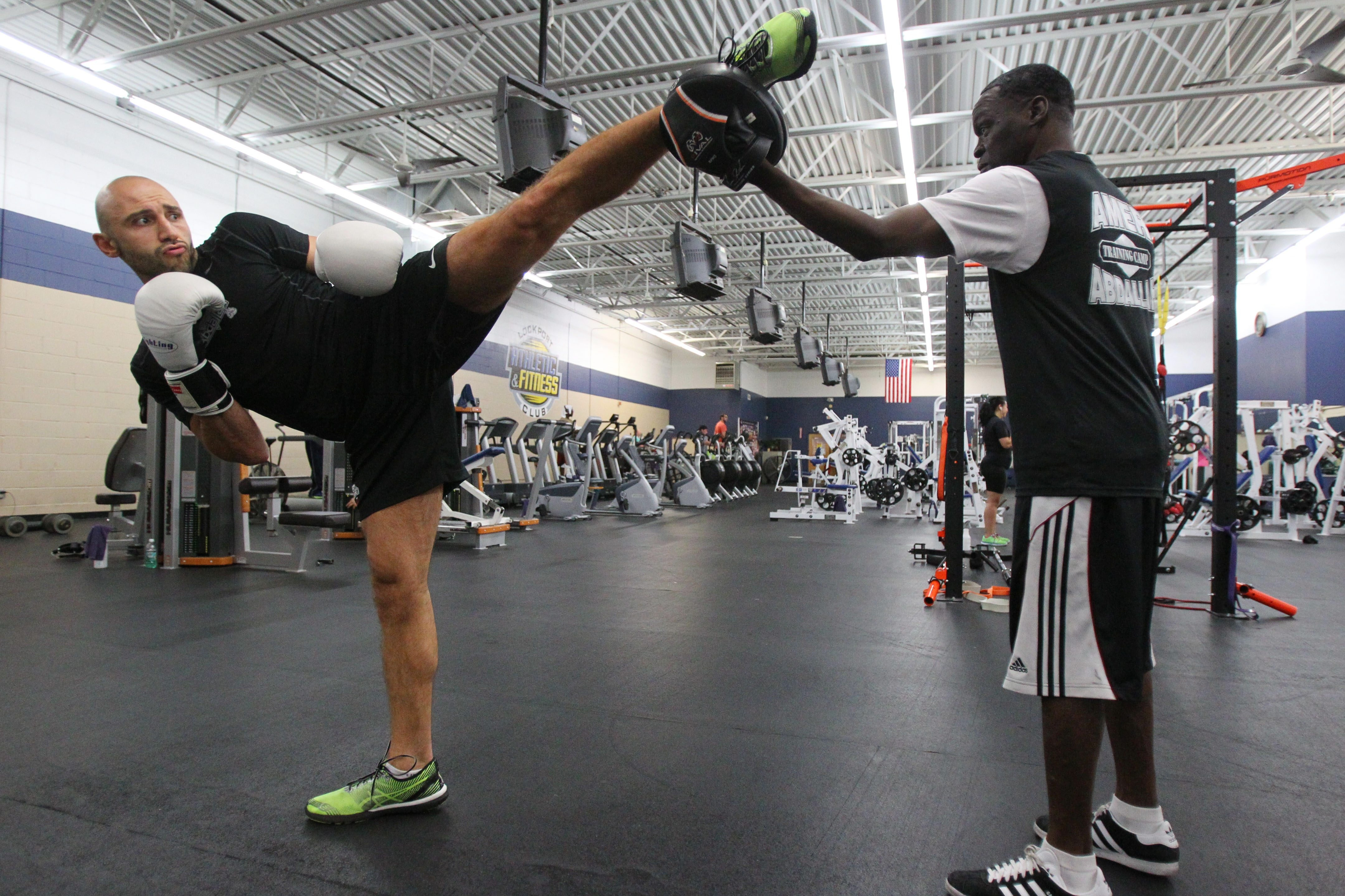 Kickboxer Amer Abdallah of Lockport works out with trainer Jeff Mayweather at the Lockport Athletic & Fitness club.