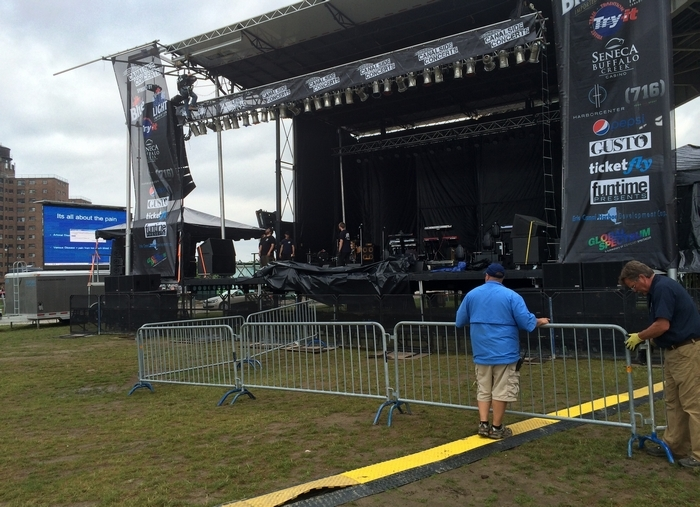 Setup continues downtown for tonight's Canalside concert. (Andra Cernavskis/Buffalo News)