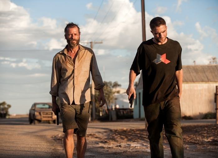 "Guy Pearce, left, and Robert Pattinson star in ""The Rover."""