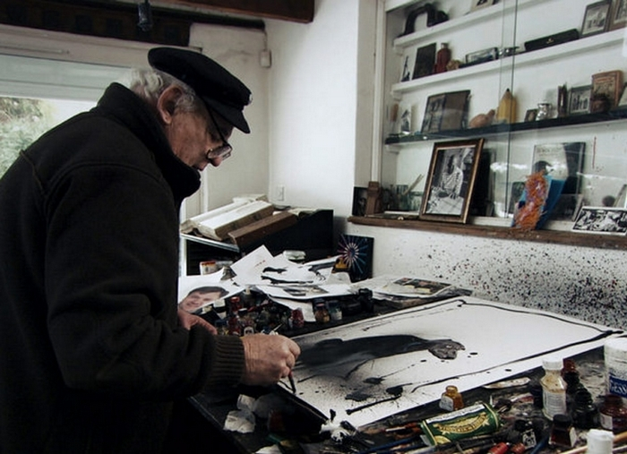 """Illustrator Ralph Steadman, shown working on a new piece in the documentary """"For No Good Reason,"""" is best known for his work with writer Hunter S. Thompson."""