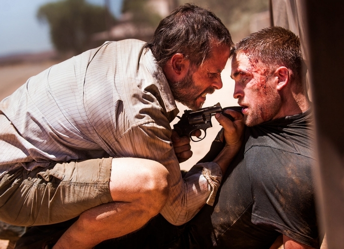"Guy Pearce, left, and Robert Pattinson show their gritty outback sides in ""The Rover."""