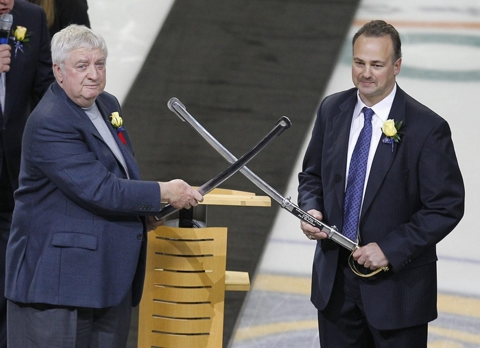 Rick Jeanneret and Dale Hawerchuck with their swords before the start of the game Tuesday, November 8, 2011.{Photo by Mark Mulville / Buffalo News}
