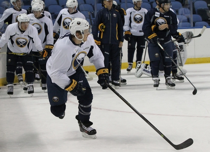 No. 1 draft pick Sam Reinhart skates with the puck at the first day of Sabres development camp in the First Niagara Center on Monday. (James P. McCoy/Buffalo News)
