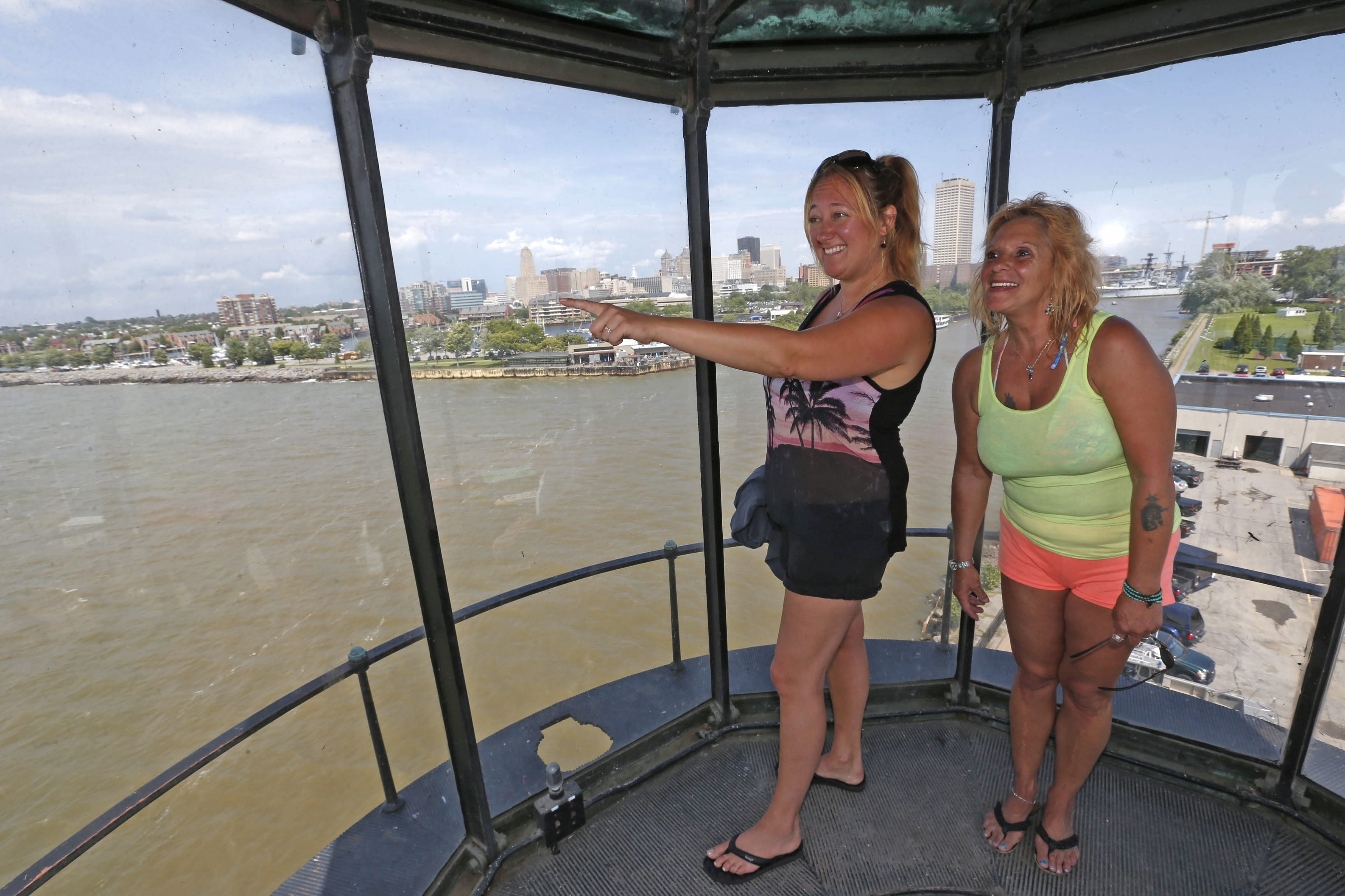 Heidi Plowe and Pam Diana of Santa Cruz, Calif., take in the view of the harbor from the top of the Buffalo Lighthouse on Thursday.