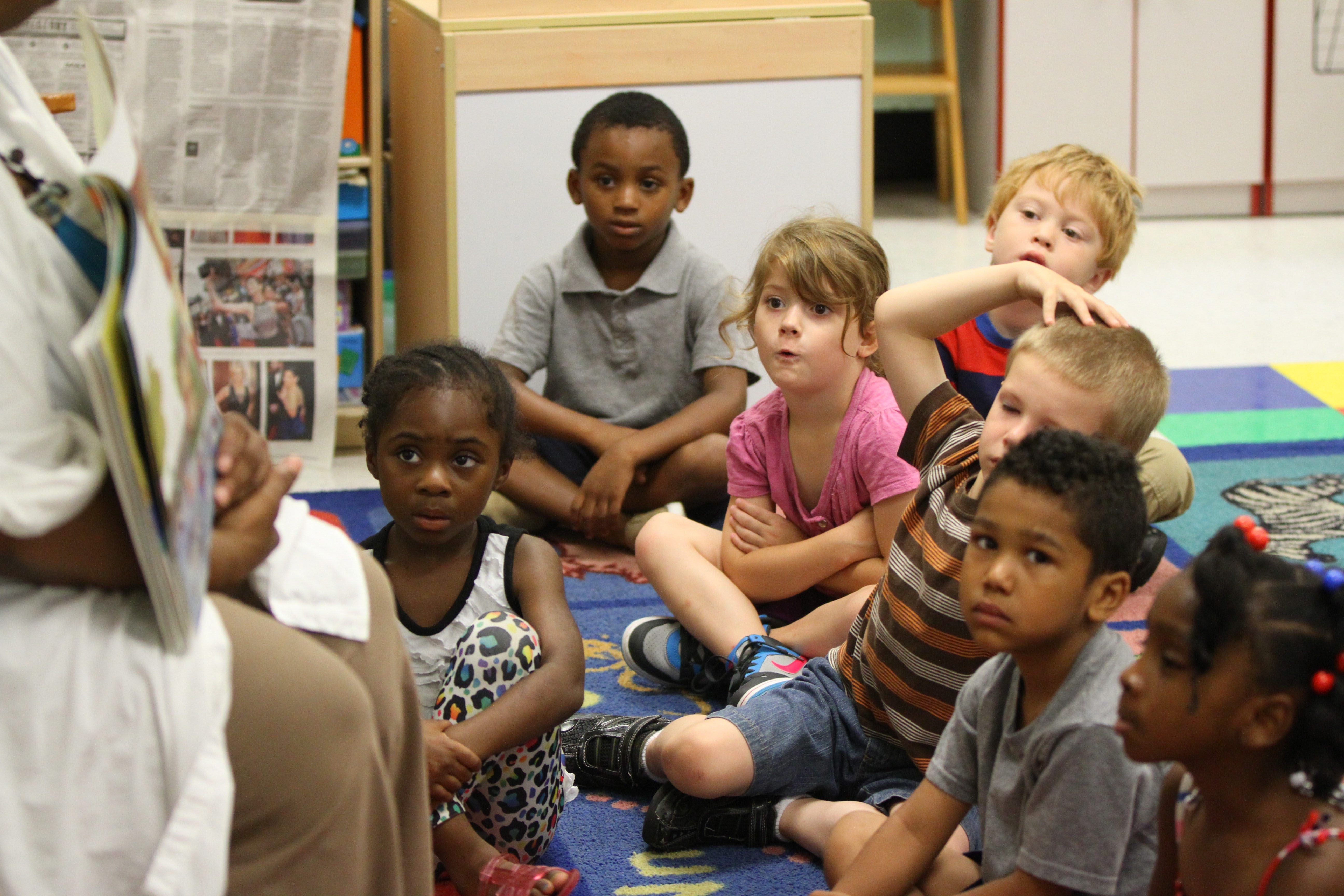 Pre-K students listen to a story at the Dr. George E. Blackman School of Excellence in Buffalo on July 23. Local developers are partnering with Say Yes Buffalo to build scholarship funds.
