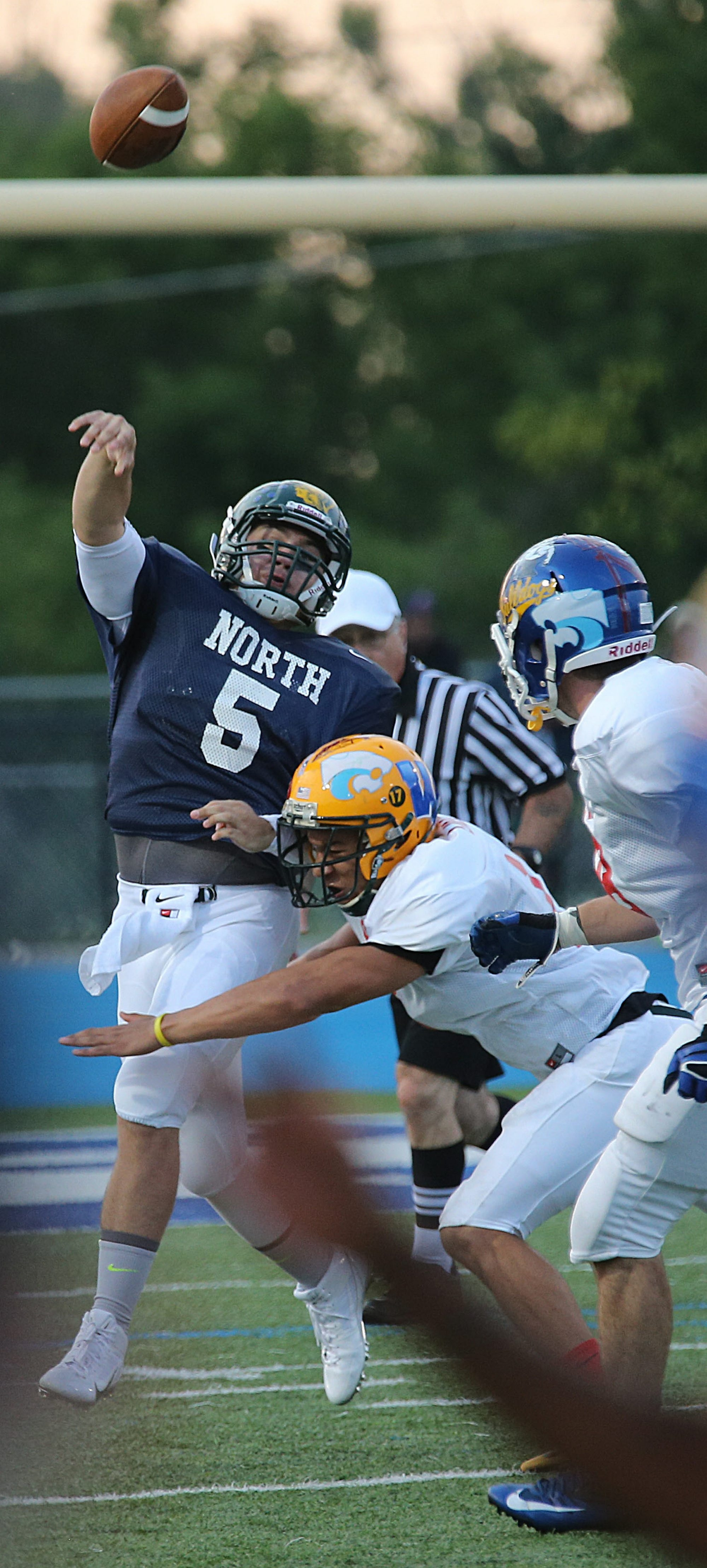 North All-Star #5, Ryan Majewski, left, throws just as he is hit by South All-Star, #17, Devin Lindner, at Depew High School, Wednesday, July 30, 2014.{Photo by Charles Lewis/Buffalo News}