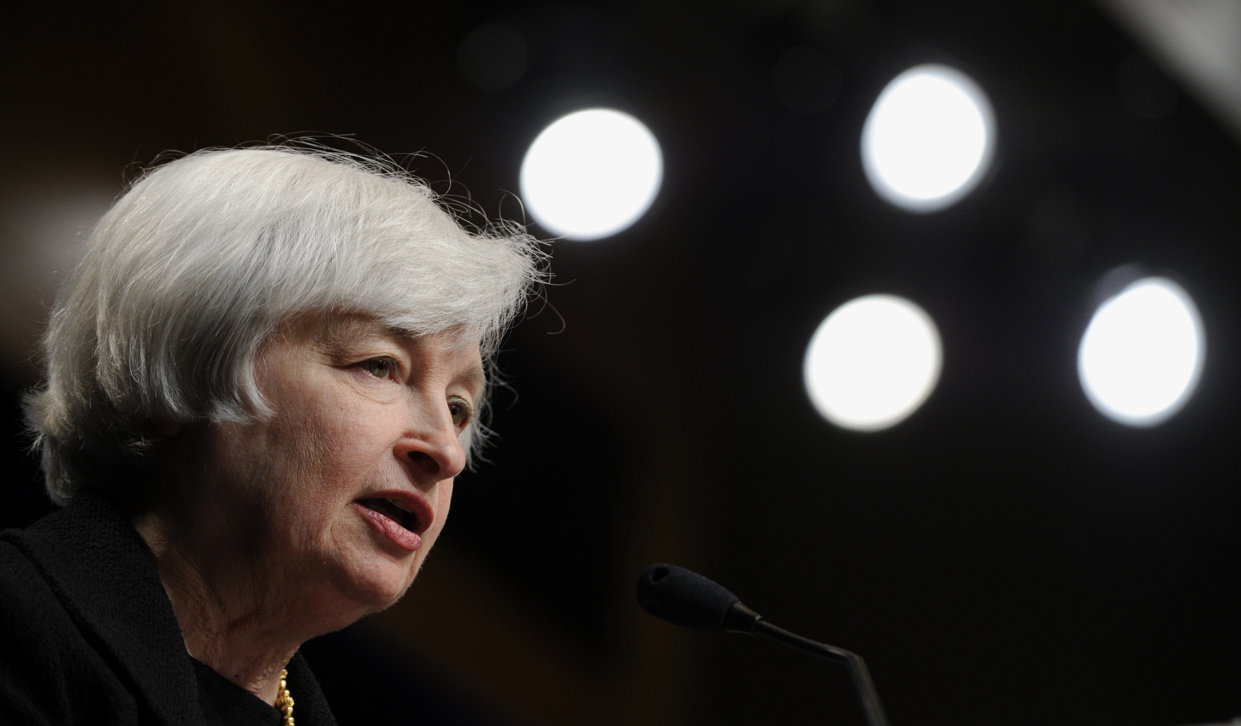 Fed Chairwoman Janet L. Yellen sees weak wage growth, underem- ployment as reasons for concern.