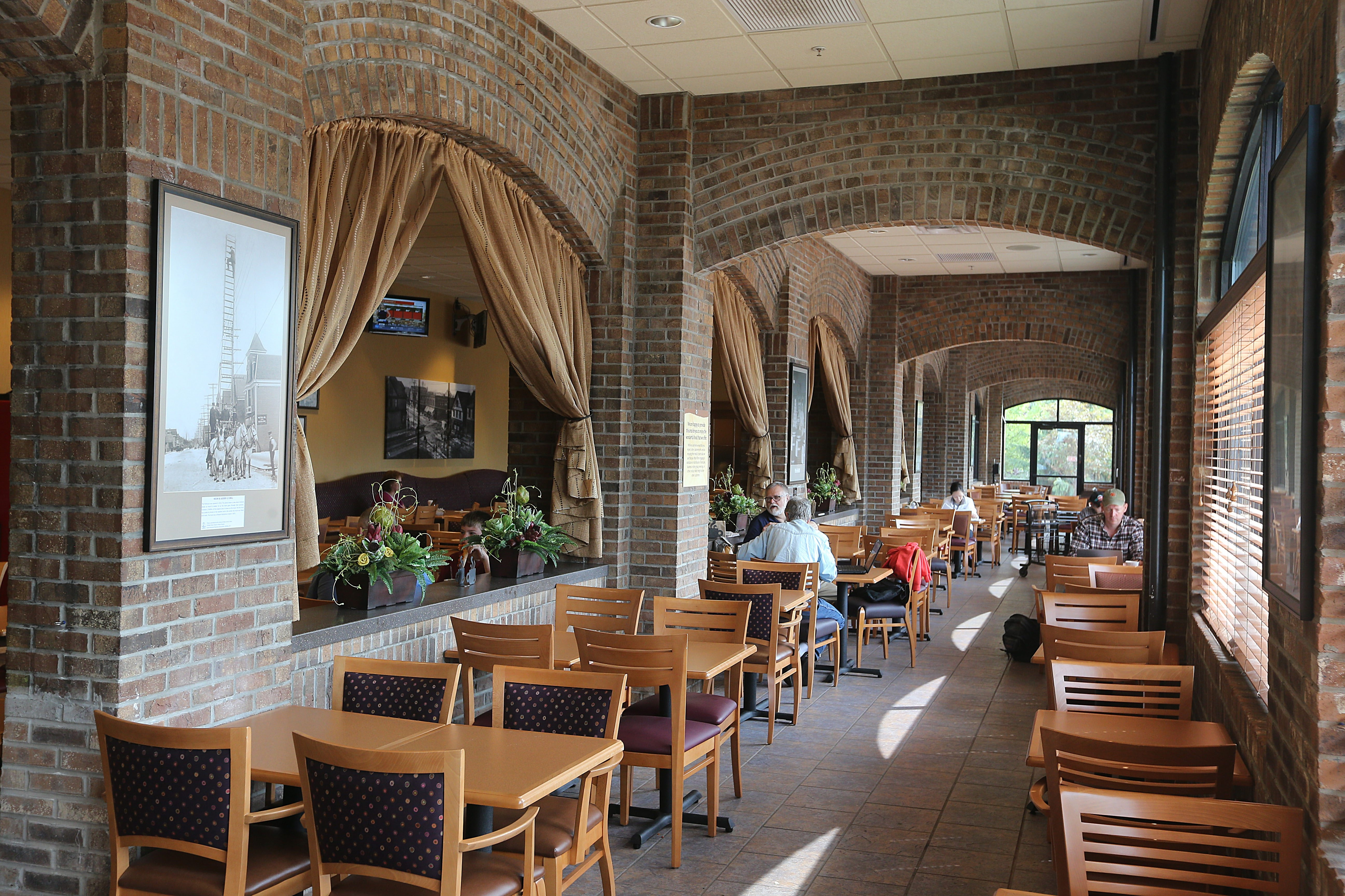 Customers sit in the recently renovated dining area at the Wegmans Supermarket on Amherst Street in Buffalo.