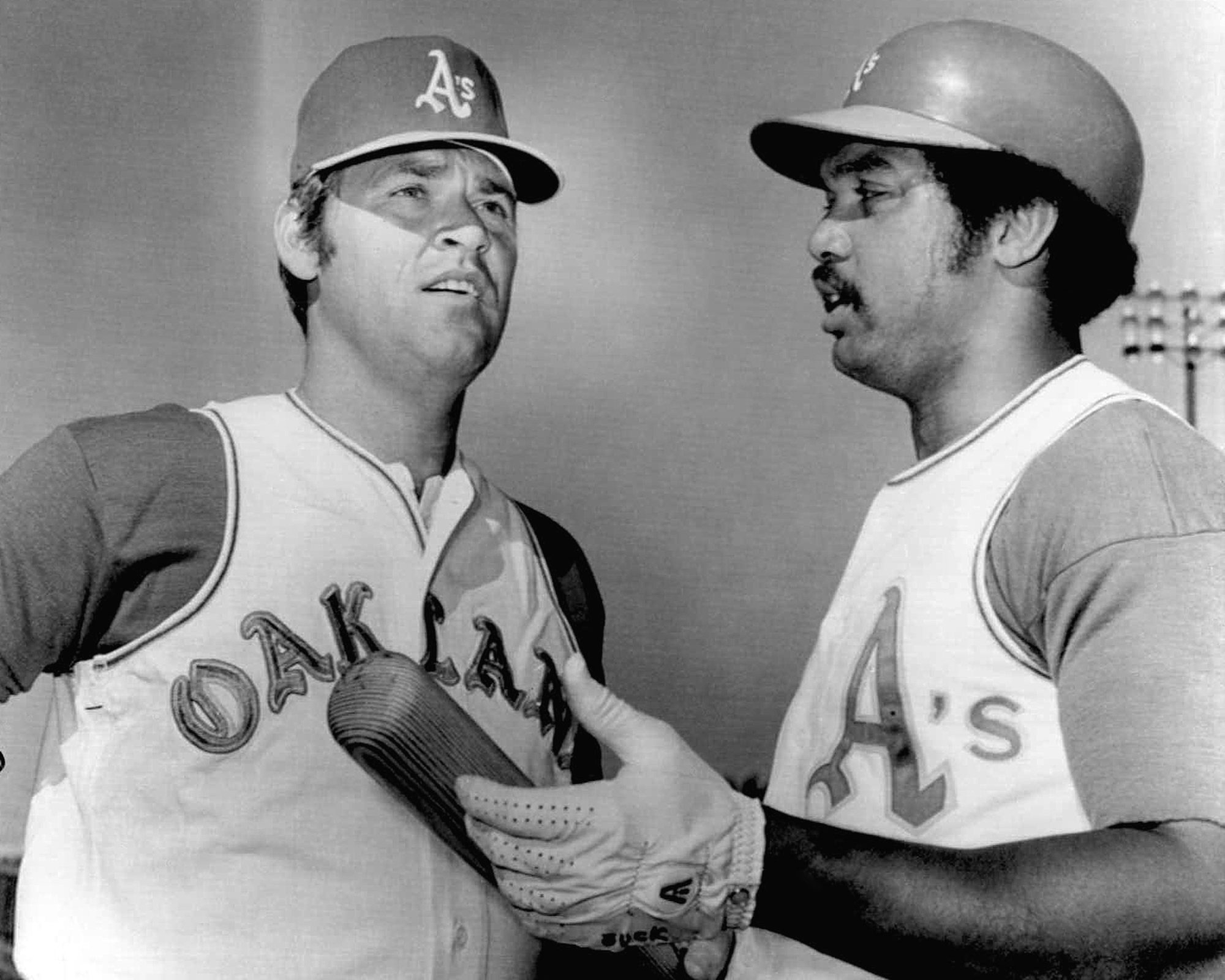 Denny McClain, left, is greeted by new teammate Reggie Jackson after he was traded from Texas to the Oakland A's in 1972.