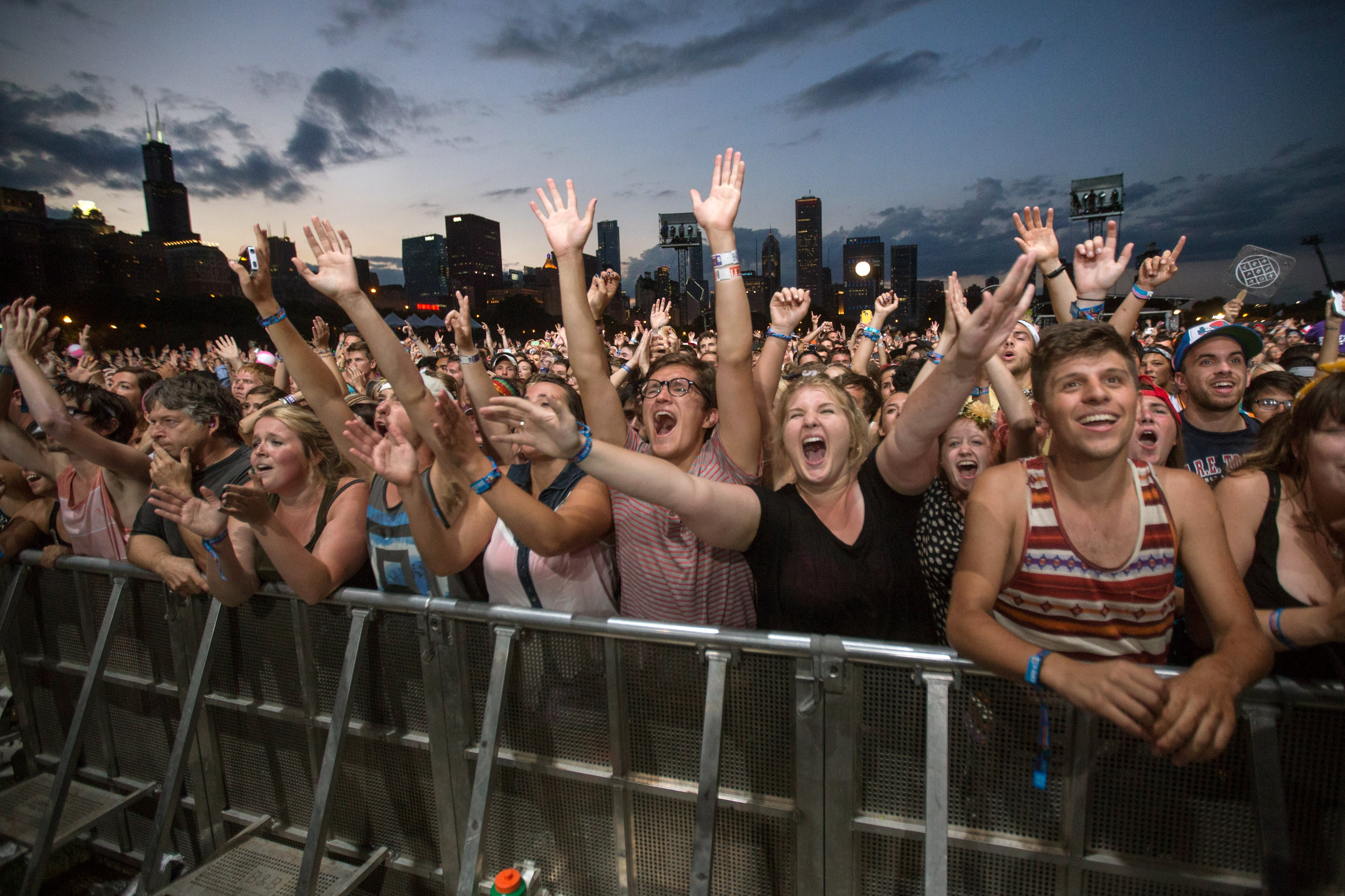 Fans watch Mumford & Sons perform at Lollapalooza last Aug. 3 in Chicago. The festival turns 10 this year.