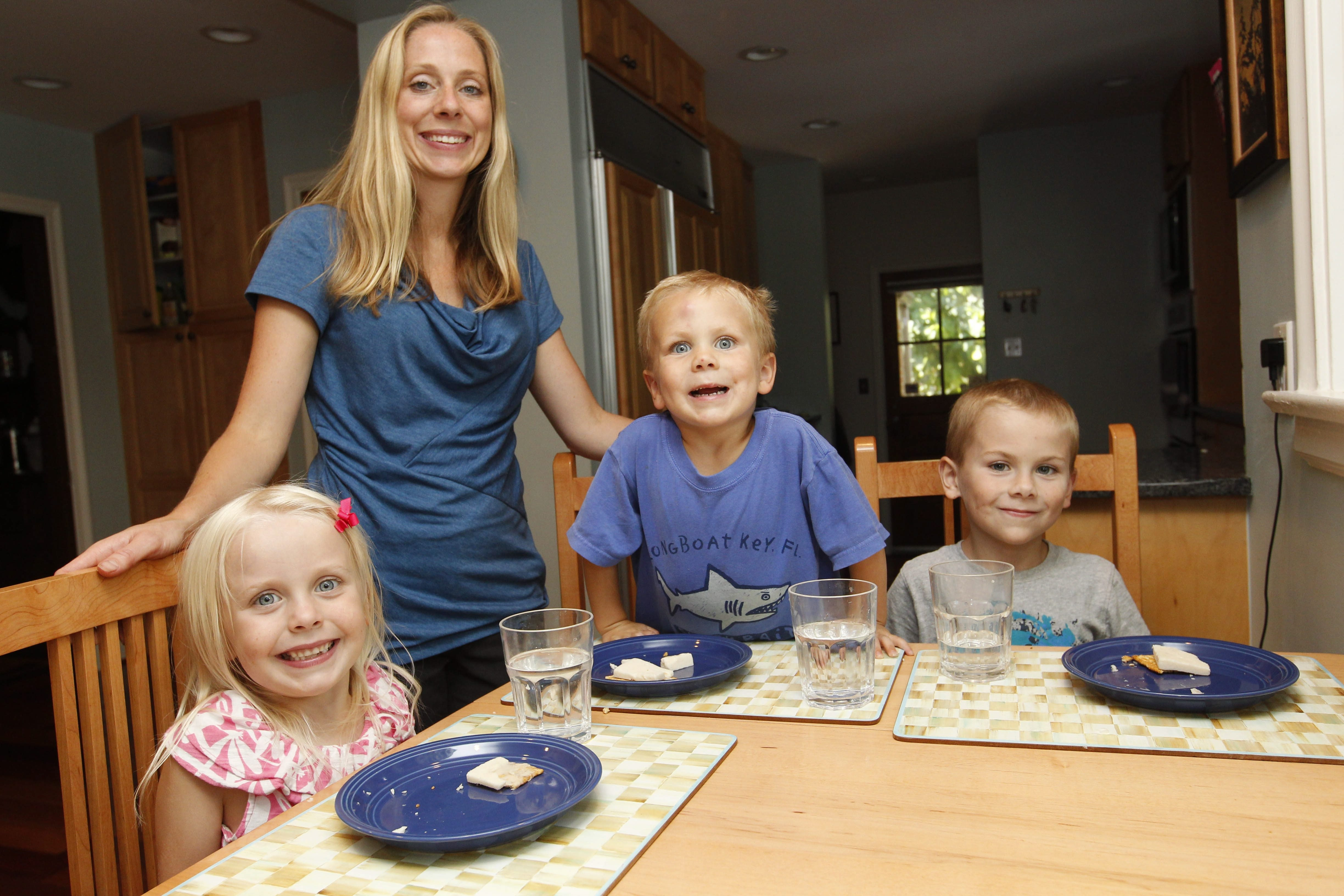 Tracy Hurley, of Amherst, gives her children an afternoon snack of vegan soy cheese on a multigrain cracker. Children, from left, are Lean, 5, Grady, 3, and Conlen, 7. Two of her three children have food allergies.