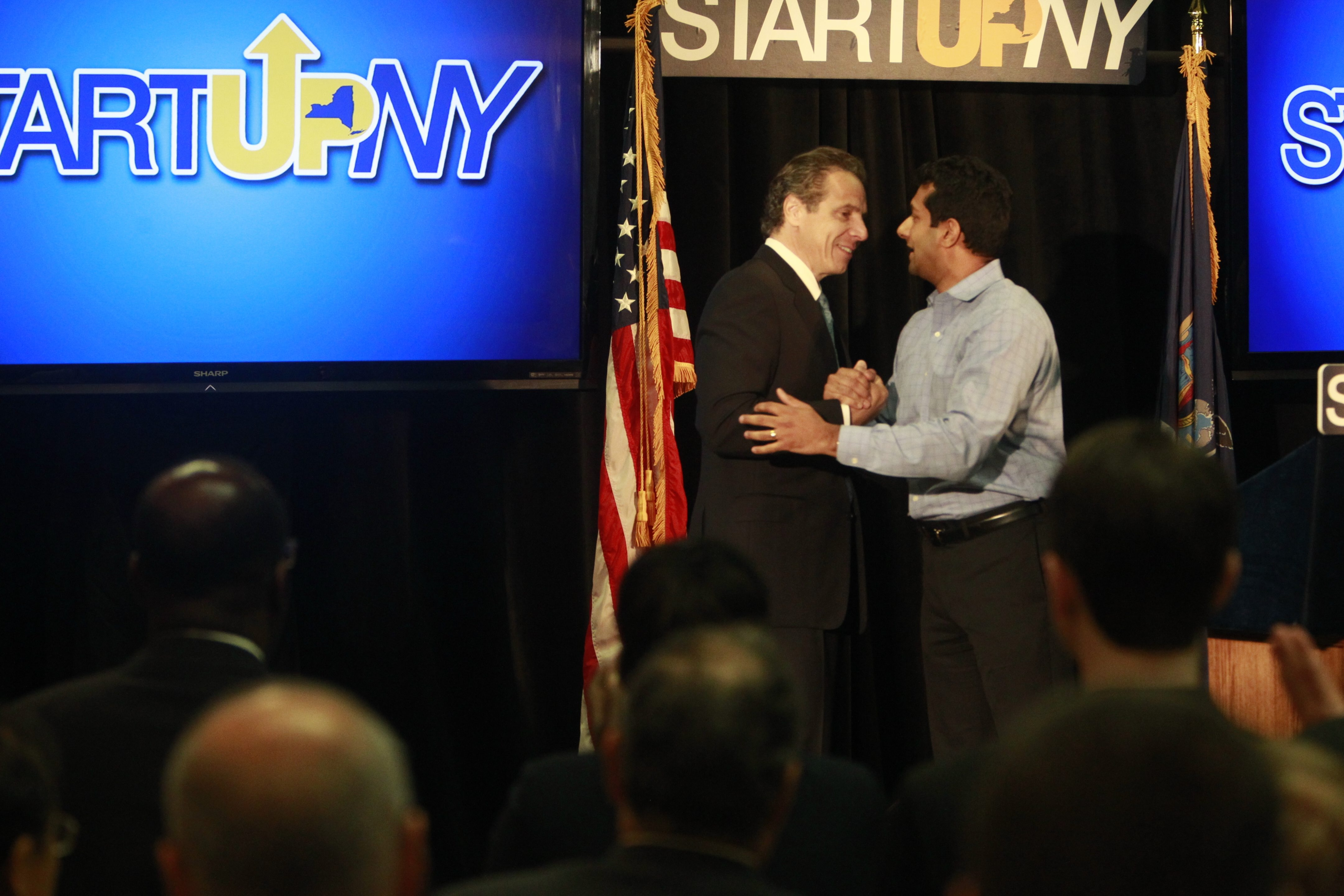 """Calling it """"a new stratosphere,"""" Ashok Subramanian of Liazon is greeted by Gov. Andrew M. Cuomo as the CEO outlines a plan for 500 more hires over five years."""