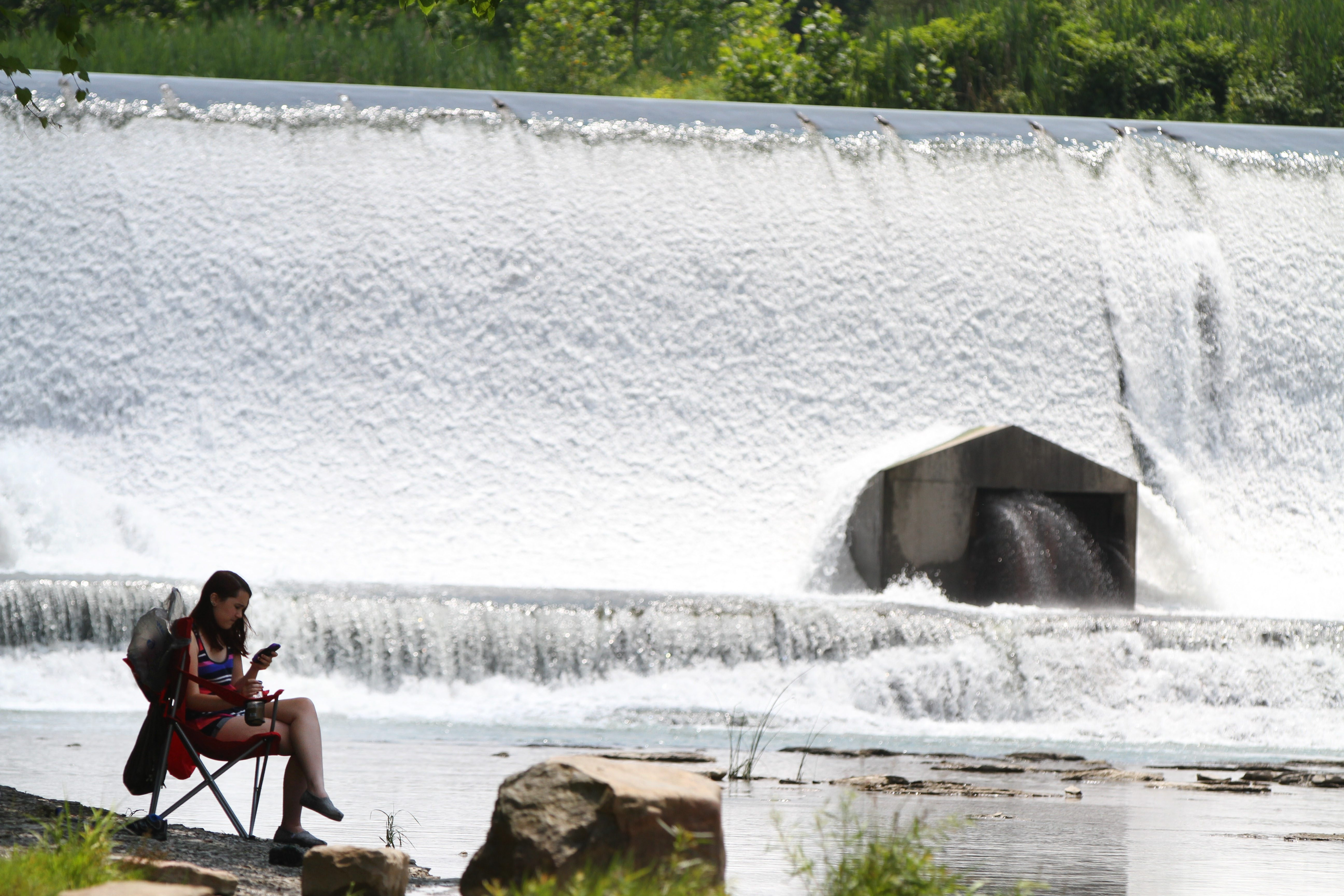 Caylee Barger enjoys a quiet day with her family at the Scoby Dam in Springville.