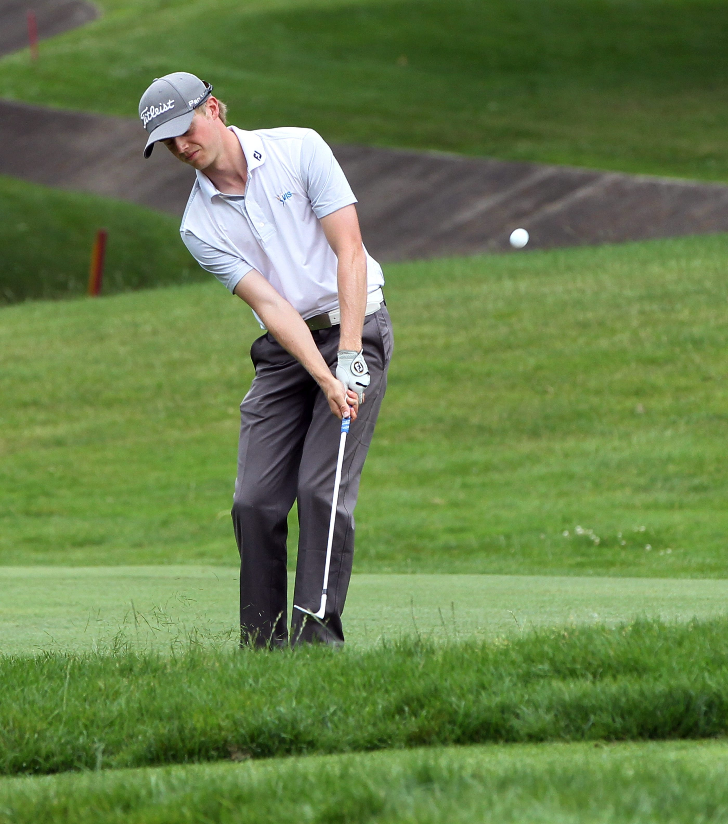 Ben Eccles hits a shot to the green on the 15th hole during the final round of the Porter Cup at the Niagara Falls Country Club.