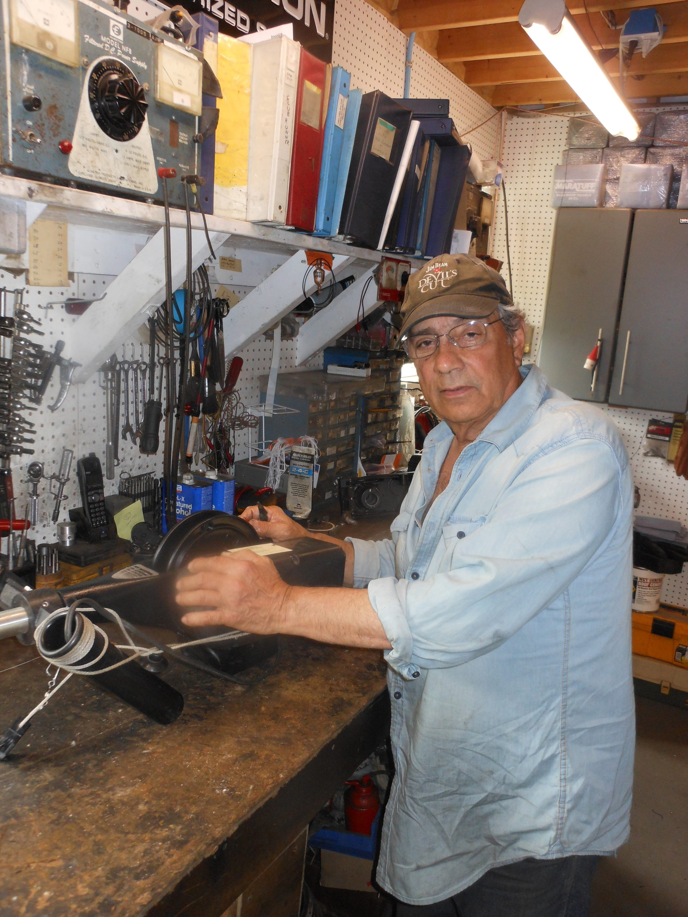 Tony the Reel Man keeps busy at his work bench in Orchard Park.
