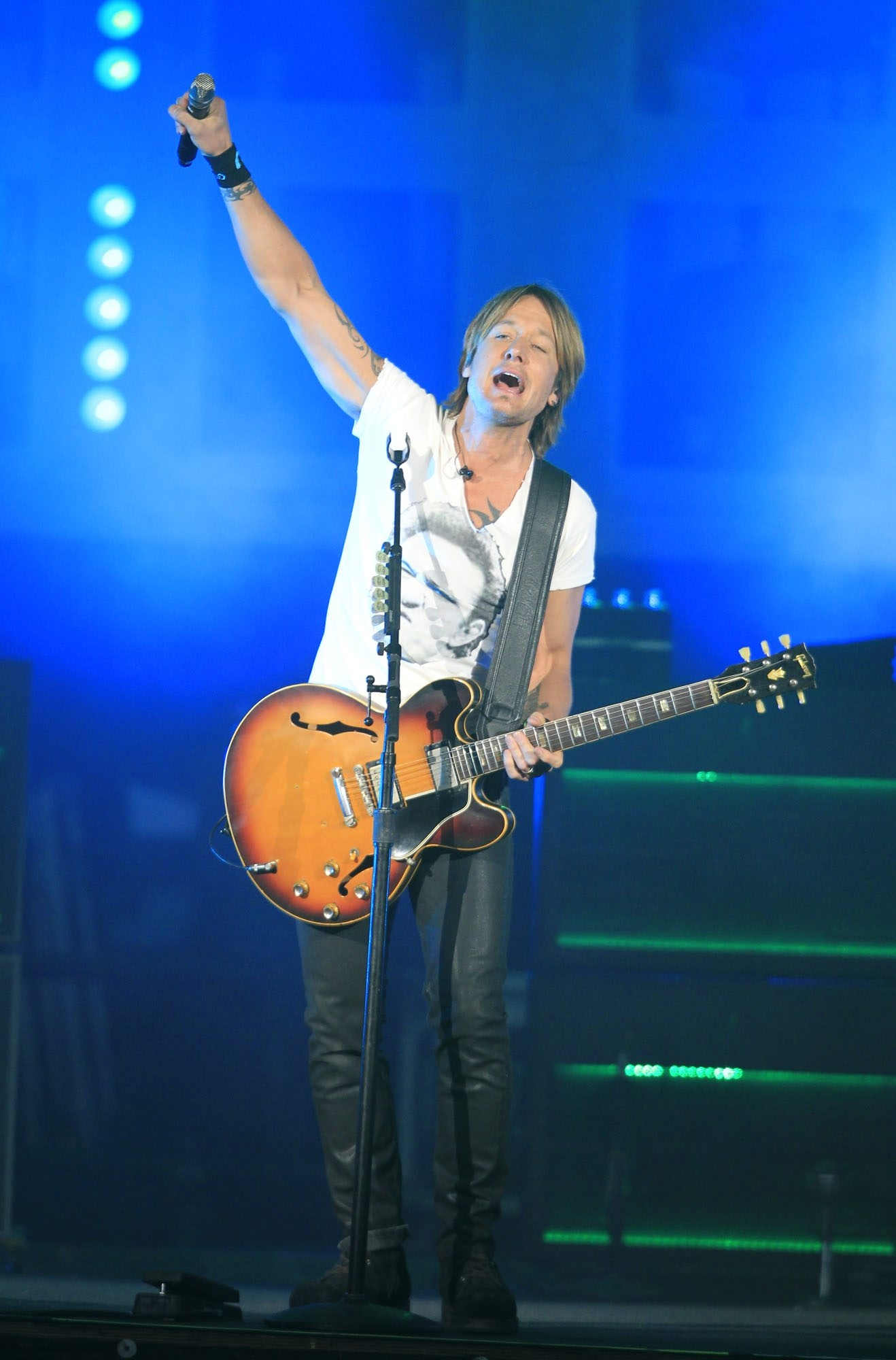 Keith Urban acknowledges the audience at Darien Lake Friday night. See a photo gallery of the concert at BuffaloNews.com.