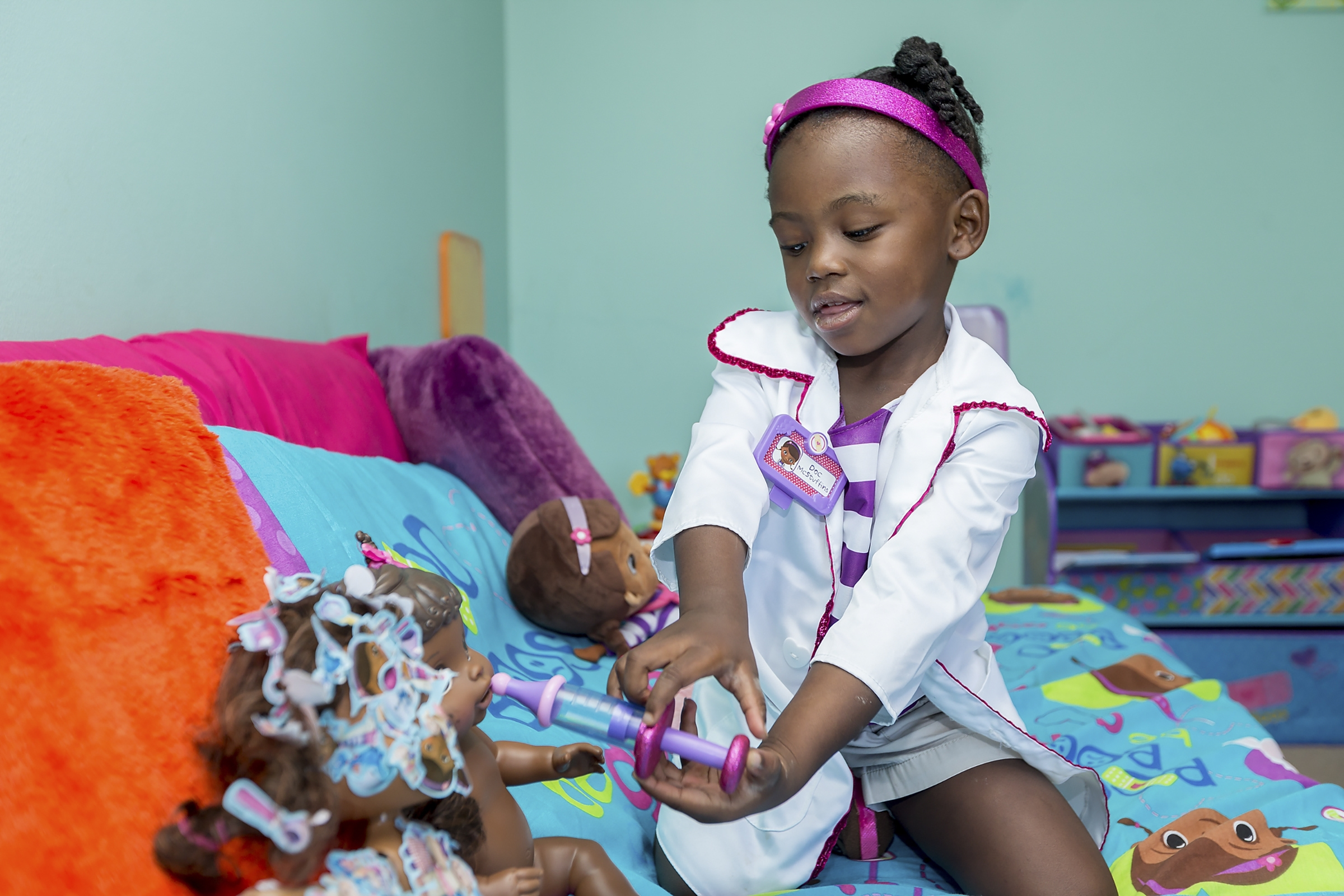Natalie Elisabeth Battles, 3, plays with Doc McStuffins toys at her home in Mabelvale, Ark., on July 3. Doc McStuffins merchandise made about $500 million in sales last year.