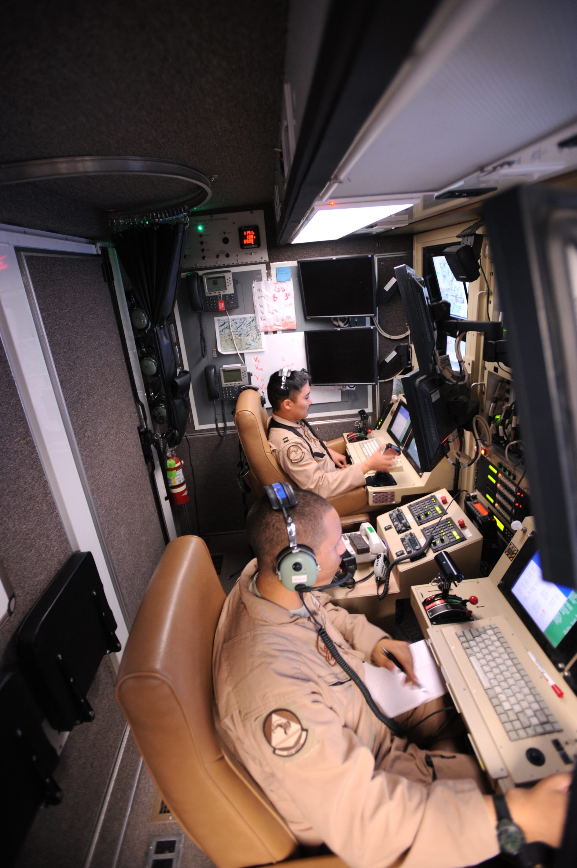 Capt. Ryan Jodoi (rear) flies an MQ-9 Reaper while Airman 1st Class Patrick Snyder controls a full motion video camera March 13 at Kandahar Air Base, Afghanistan. (U.S. Air Force photo/Staff Sgt. James L. Harper Jr.)