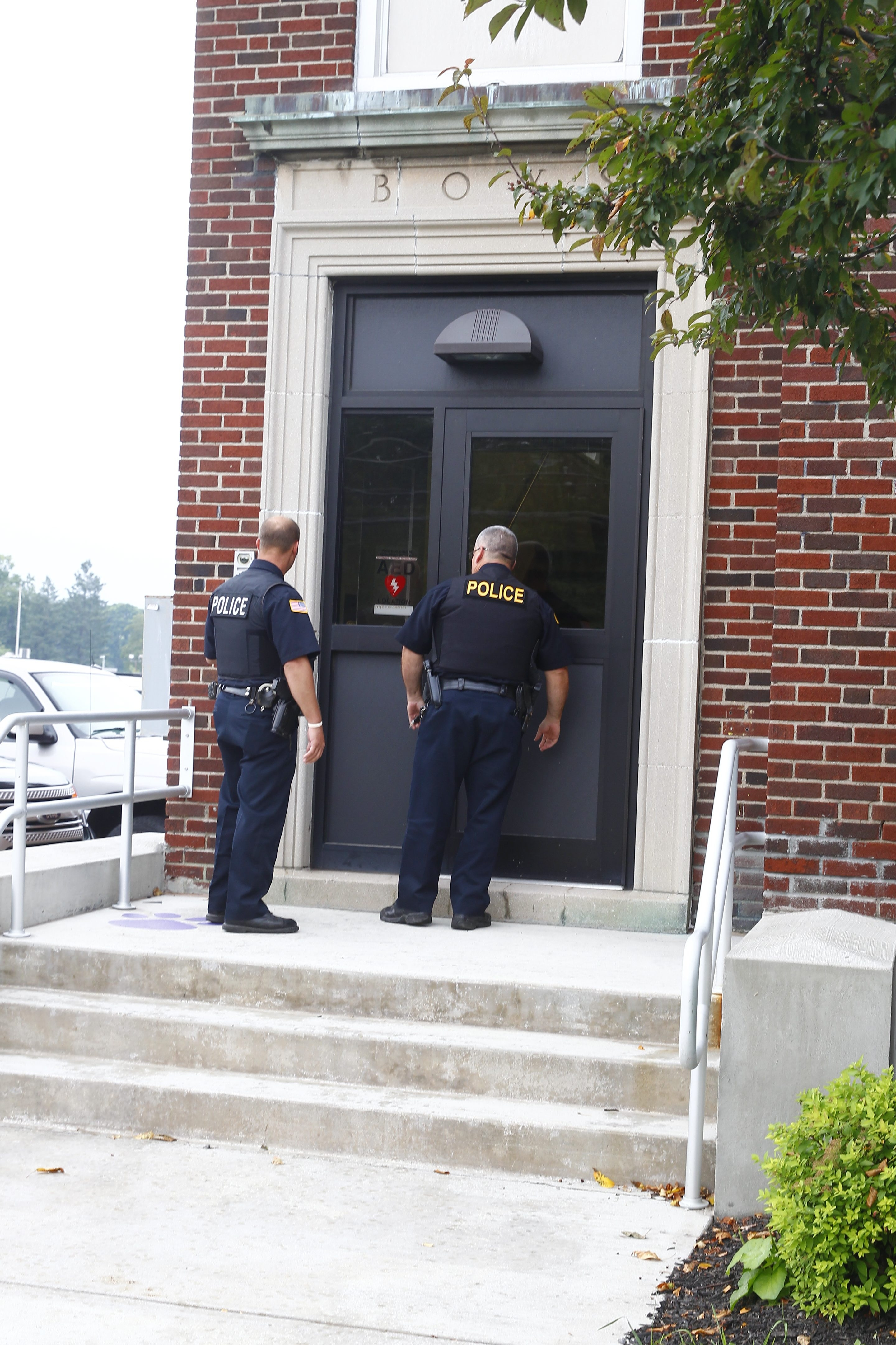 Town of Hamburg police respond to a call from a board member during Wednesday's special meeting of the school board. (John Hickey/Buffalo News)
