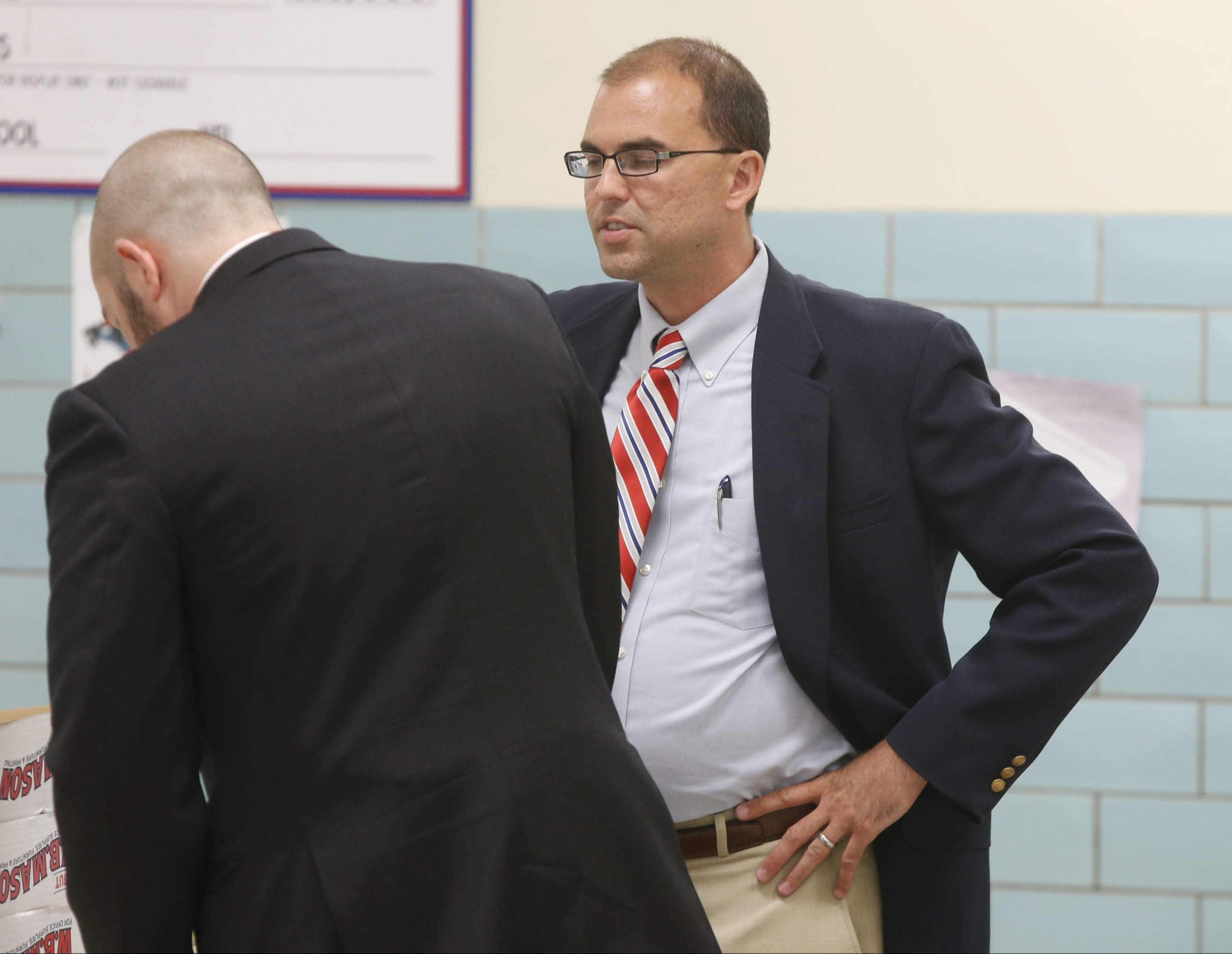 Source says Hamburg School Superintendent Richard Jetter, now on leave, admitted causing damage to his car that was originally blamed on vandalism. He's shown here speaking with district attorney Andrew Freedman, left.