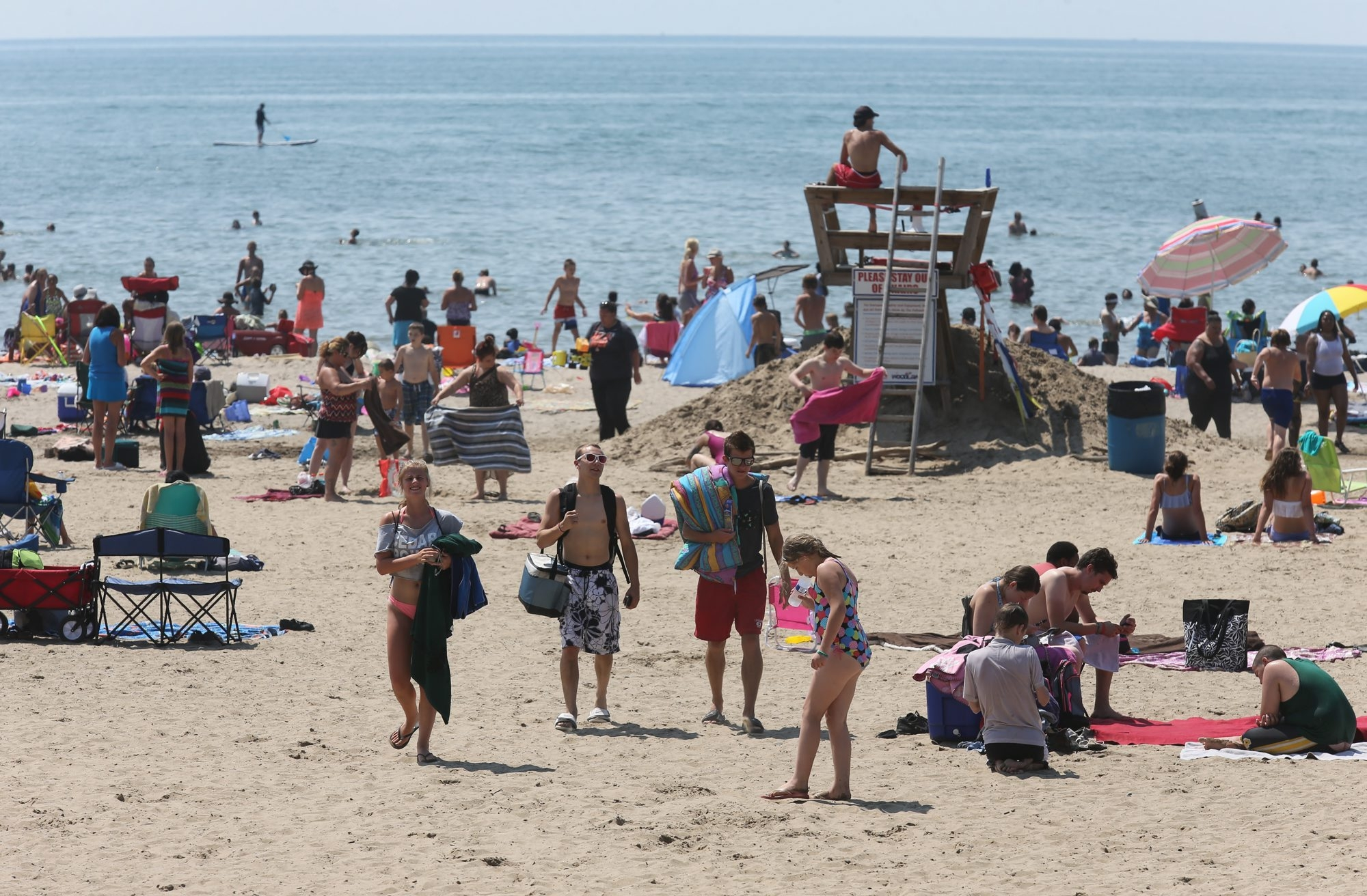 The hot weather drew a large crowd to Woodlawn Beach State Park in Hamburg on Tuesday. Traffic at the beach has been higher this summer than in recent years.