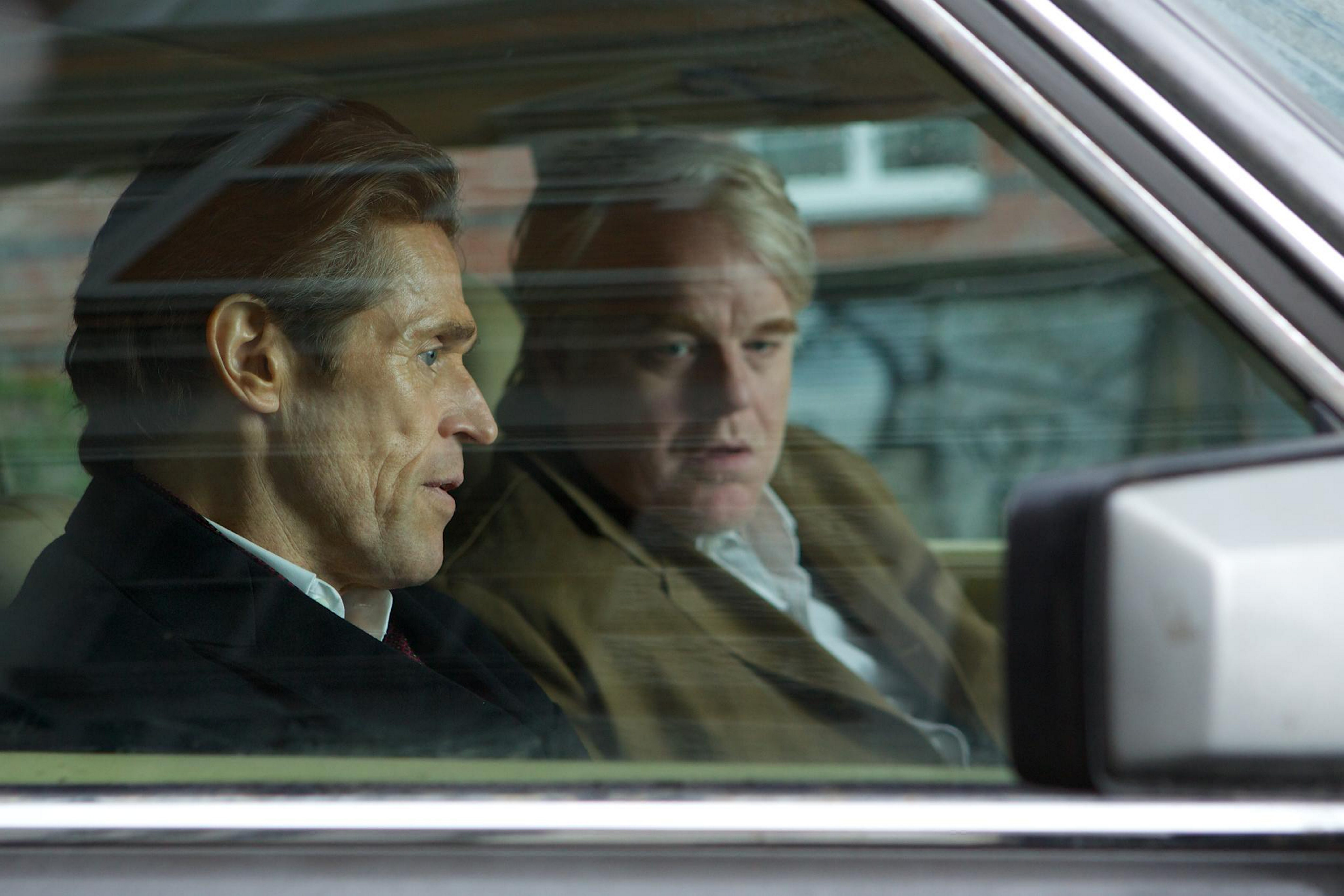 Willem Dafoe, left, and Philip Seymour Hoffman excel as John le Carré characters.