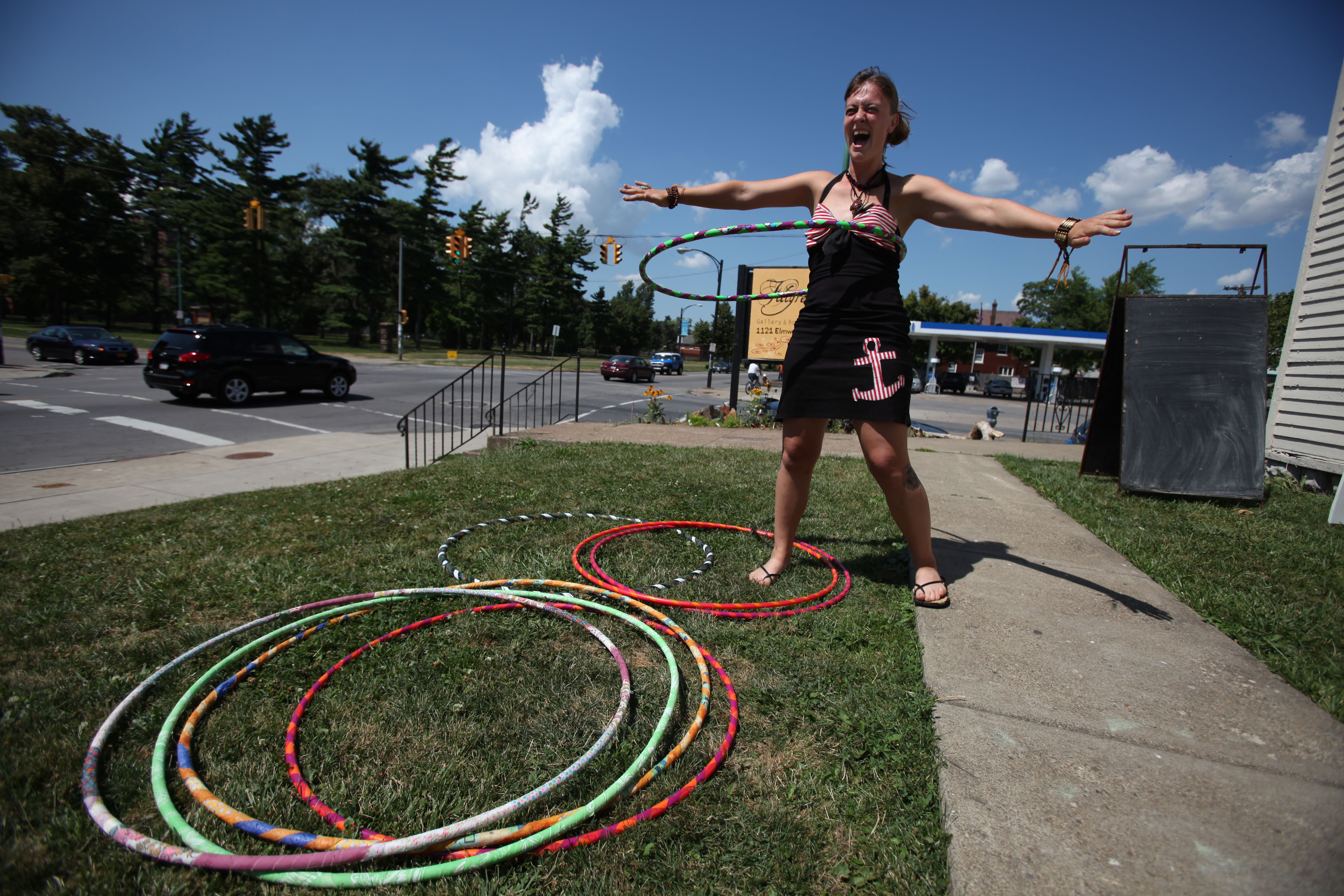 Melissa Campbell hula-hoops outside of Filigrees Gallery & Boutique on Elmwood, one of the many sites of the 2014 Buffalo Infringement Festival. (Charles Lewis / Buffalo News file photo)