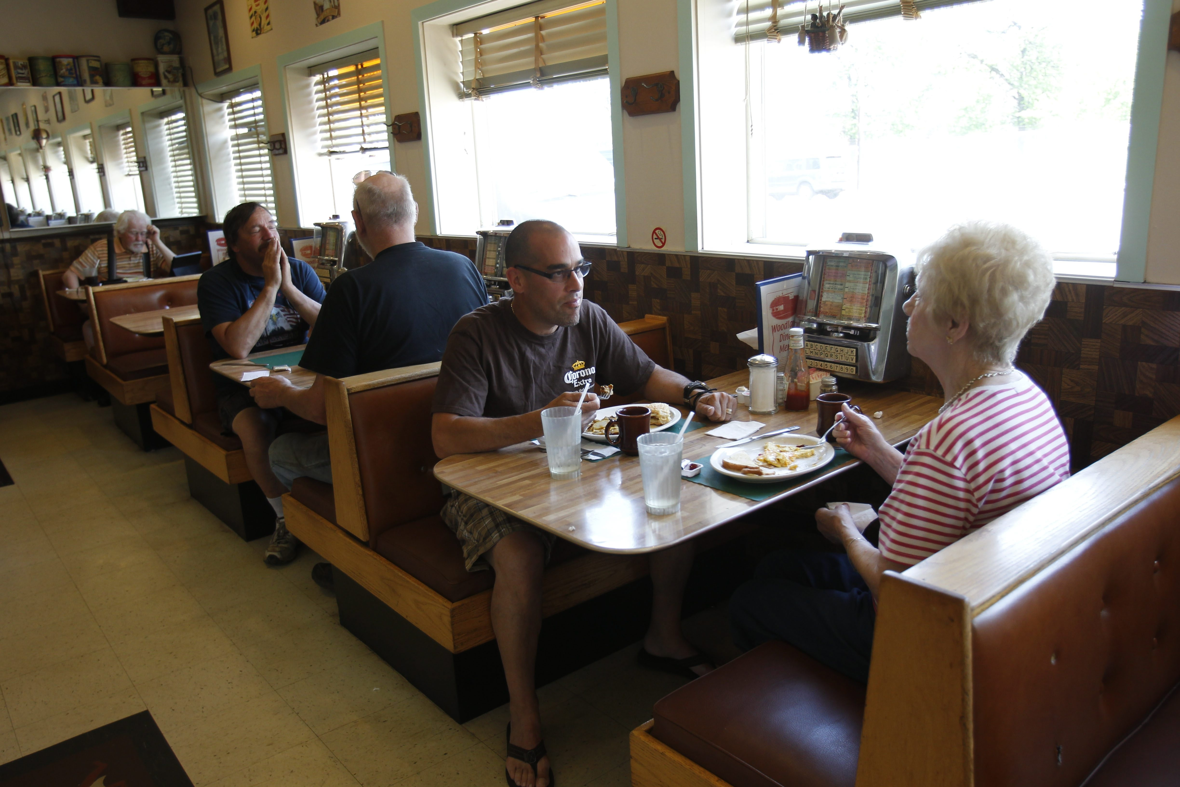 Neighbors Raymond Rivera and Mary Ann Najuch enjoy lunch recently in the Woodlawn Diner on Lake Shore Road in Blasdell.