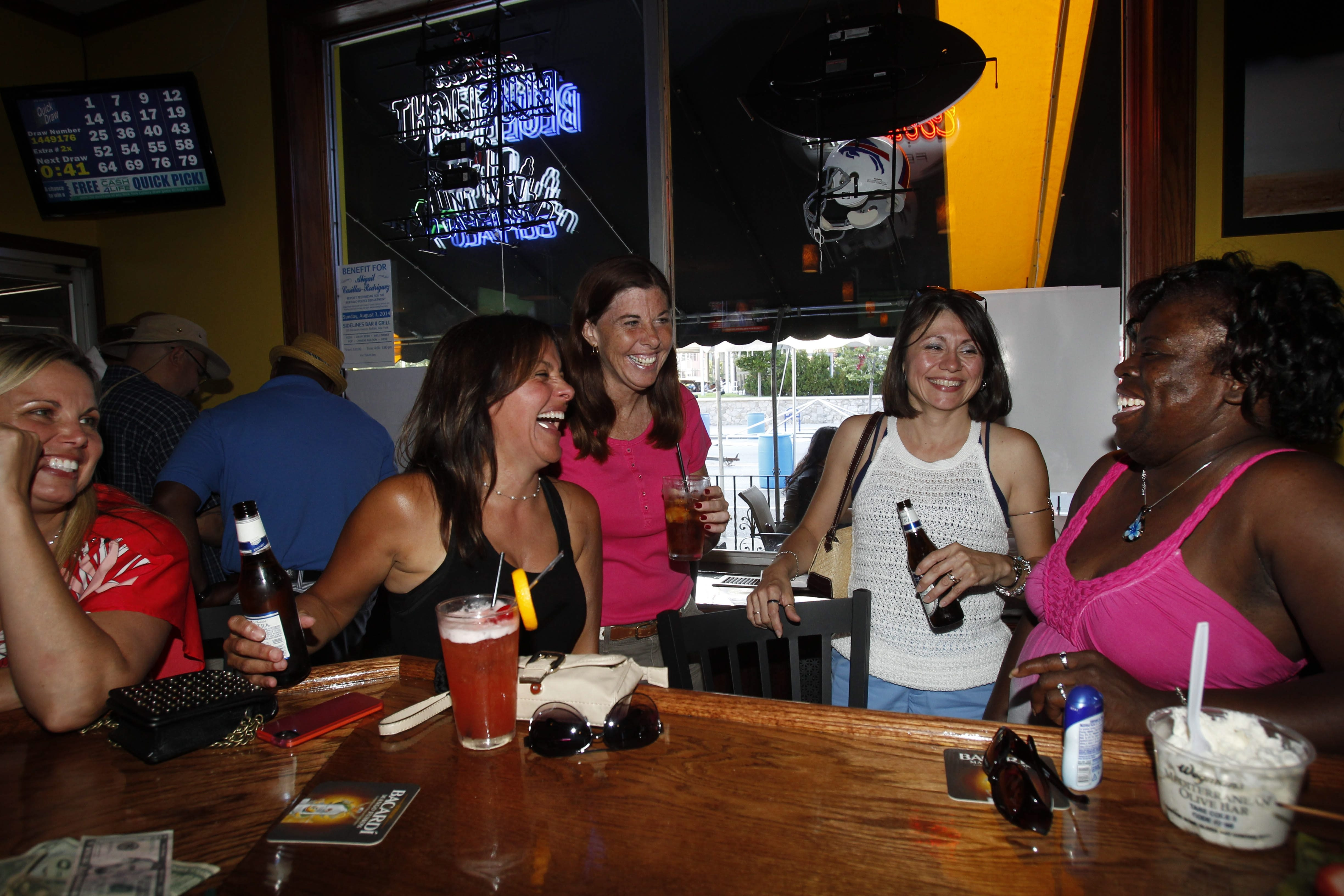 Enjoying a laugh and some drinks at Sidelines Sports Bar and Grill on Delaware Avenue are, from left, Joanne DiPasquale, Wendy Collier, Cheryl Campbell, Delilah Ventura and Cece Knight.