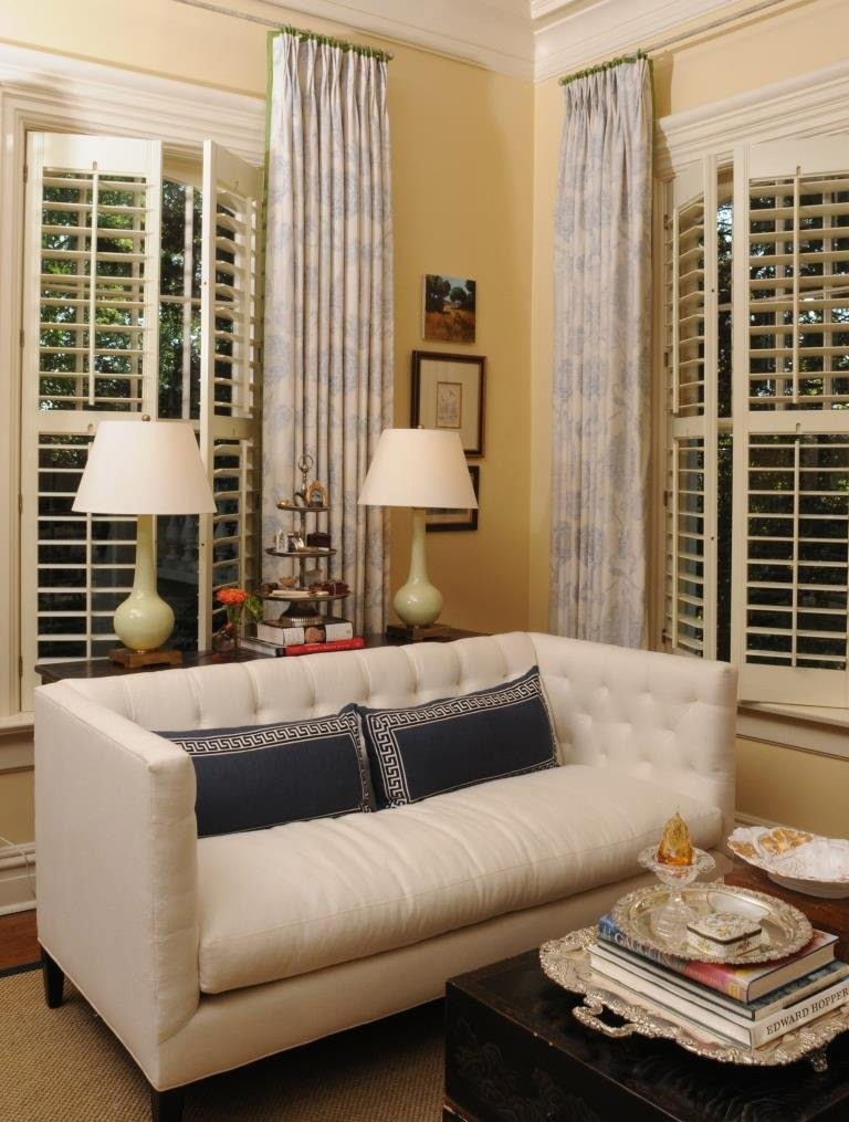 A room isn't complete without some kind of window treatment. Here, panels hang a few inches below the ceiling molding.