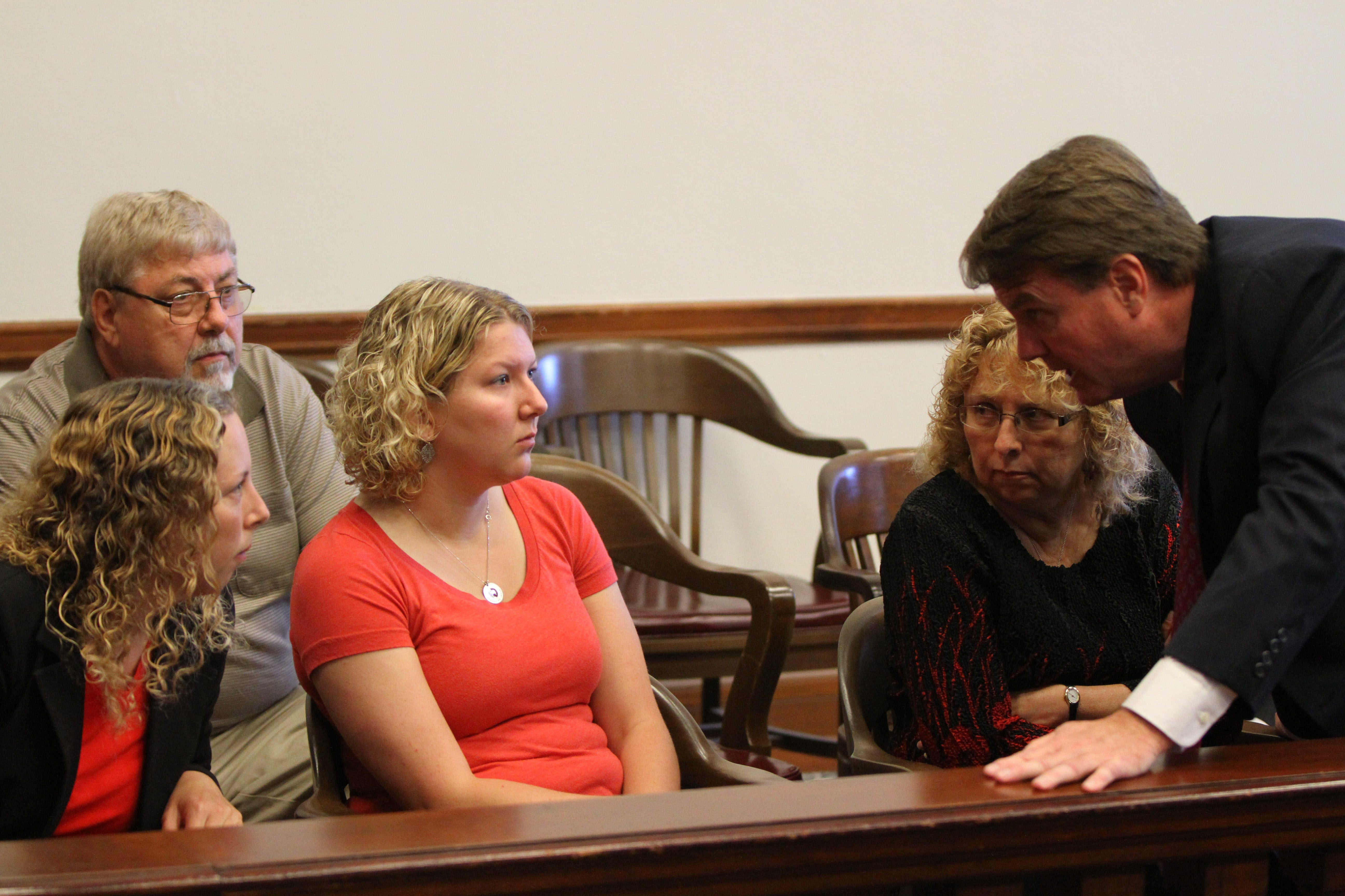 Attorney Philipp L. Rimmler speaks with Karen Wielinski, right, and her daughters, Jill Hohl, center, and Kimberly Lipiarz, in the courtroom before Tuesday's hearing. Bill Wielinski, Douglas C. Wielinski's brother, is in the background. (Mark Mulville/Buffalo News)