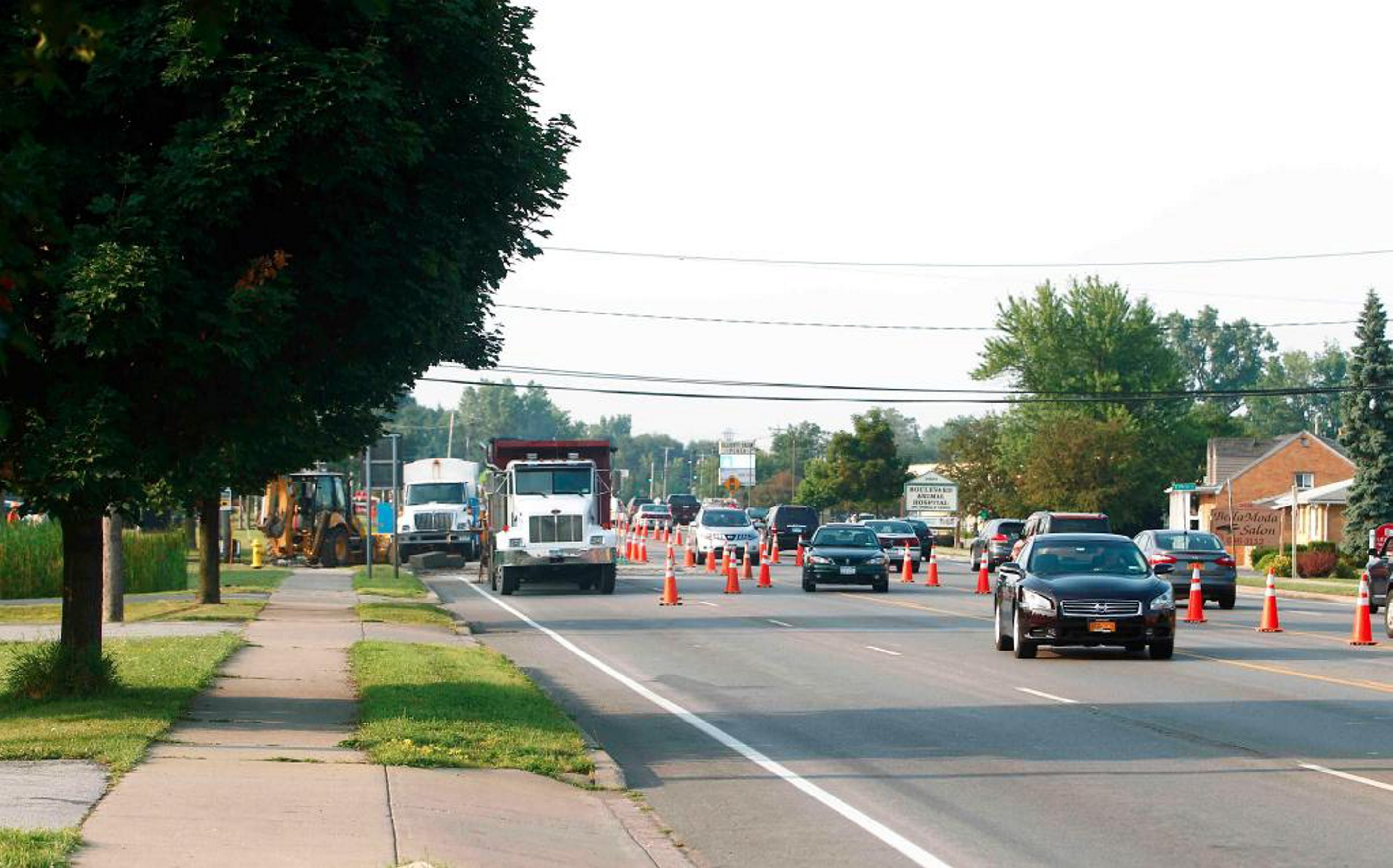 Traffic cones mark northbound lanes closure on Niagara Falls Boulevard today due to a water main break at North French Road in Amherst. (John Hickey/Buffalo News)