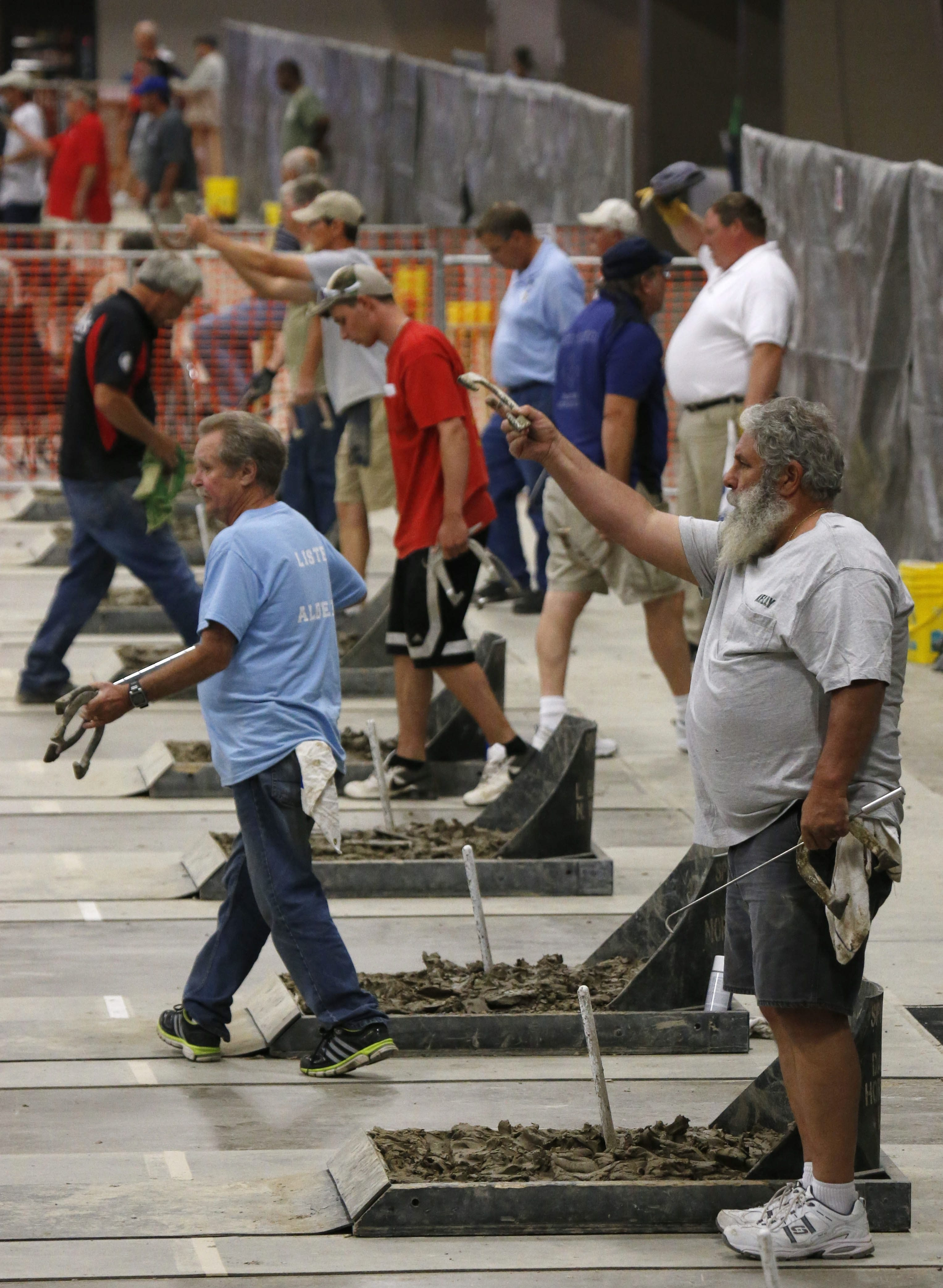 The Event Center at Hamburg Fairgrounds hosts the World Horseshoe Pitching Championships, where competition will continue until Saturday.