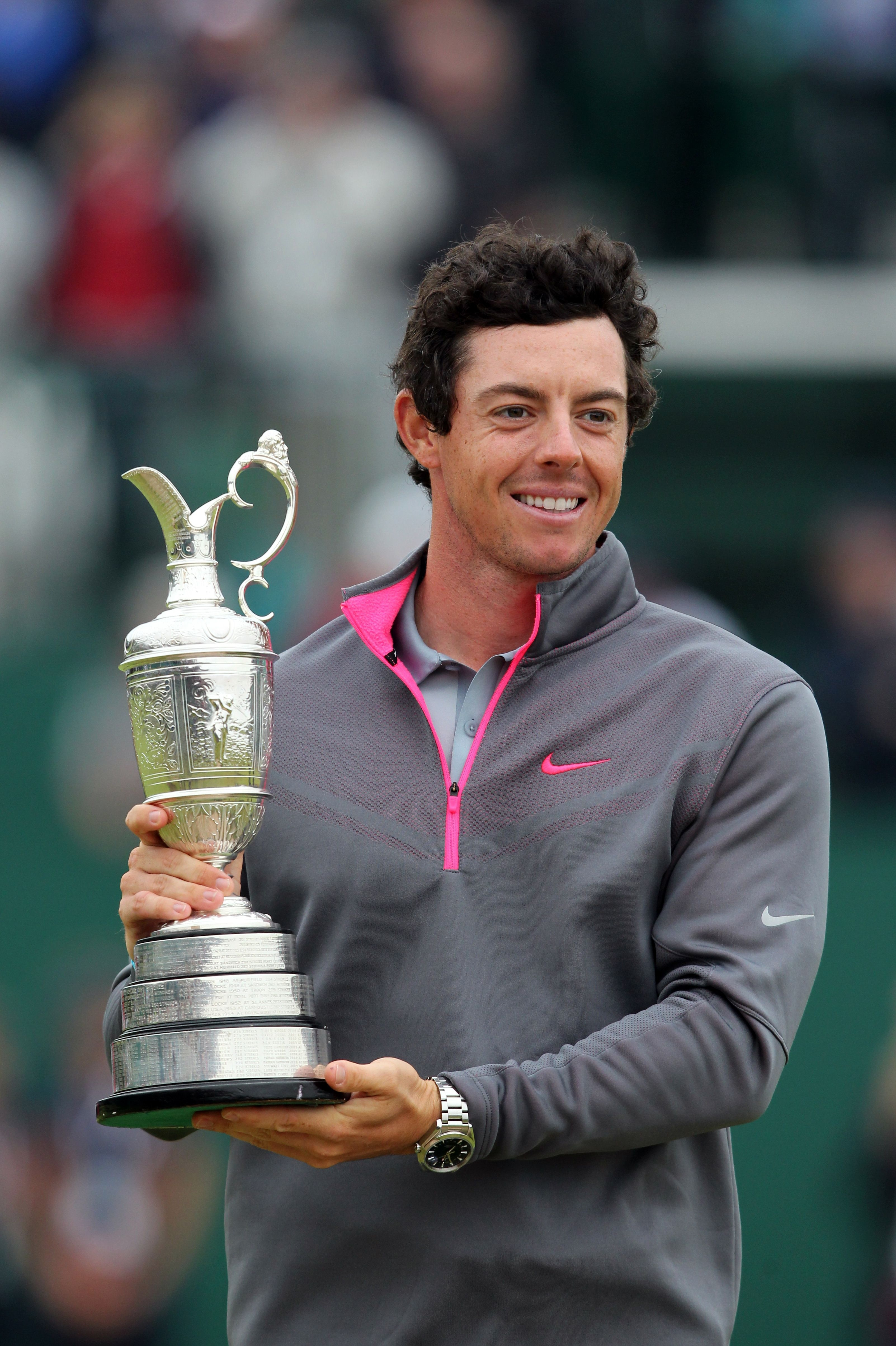 Rory McIlroy holds the Claret Jug after his win in the British Open on Sunday.
