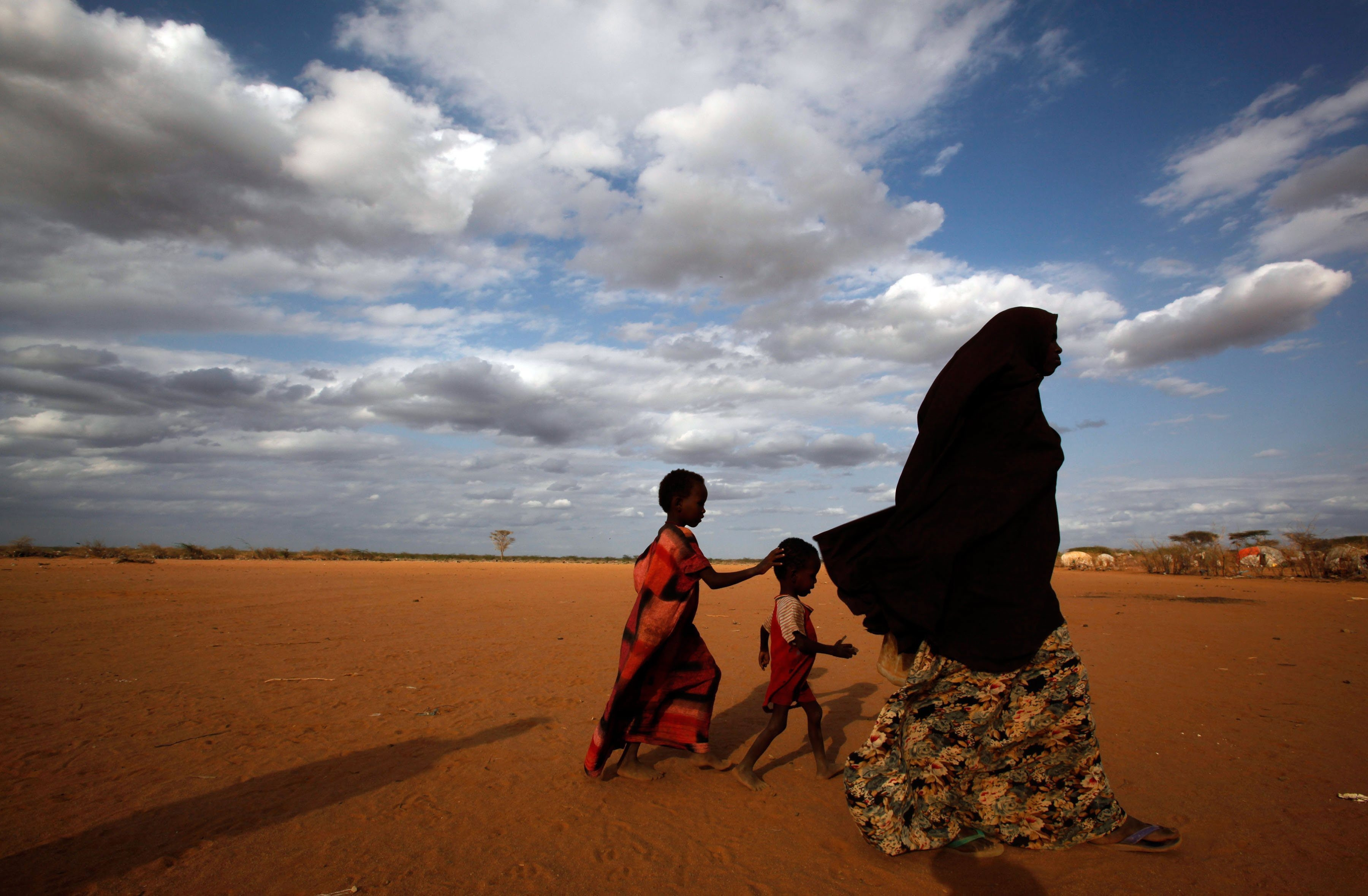 A Somali woman and her two children walk toward the outskirts of the Dagahaley refugee camp near Dadaab, Kenya. The camp is one of five spread across 20 square miles housing more than 356,000 people, mostly ethnic Somalis.