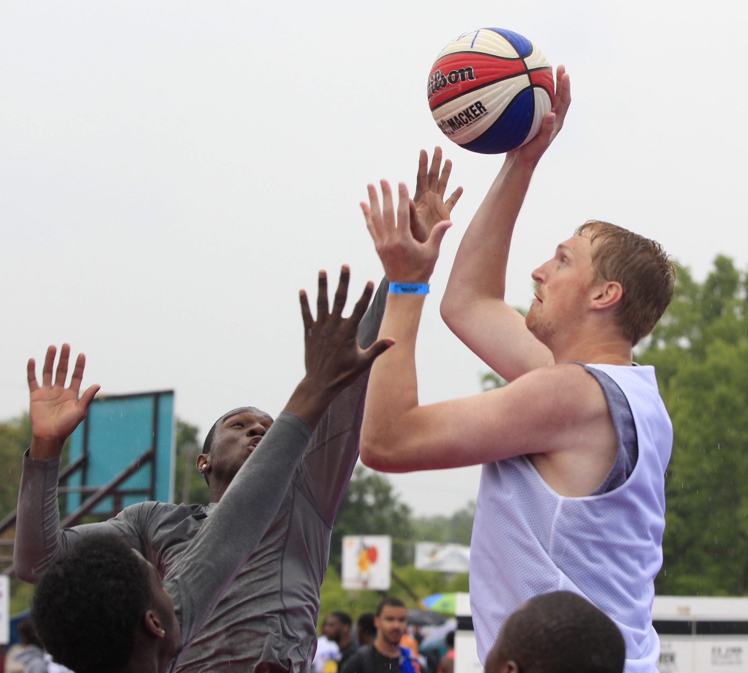 Blake McLimans, who played under coach John Beilein at Michigan, puts up two points for his Monstars 2 team. View a photo gallery from Saturday's Gus Macker action at BuffaloNews.com.