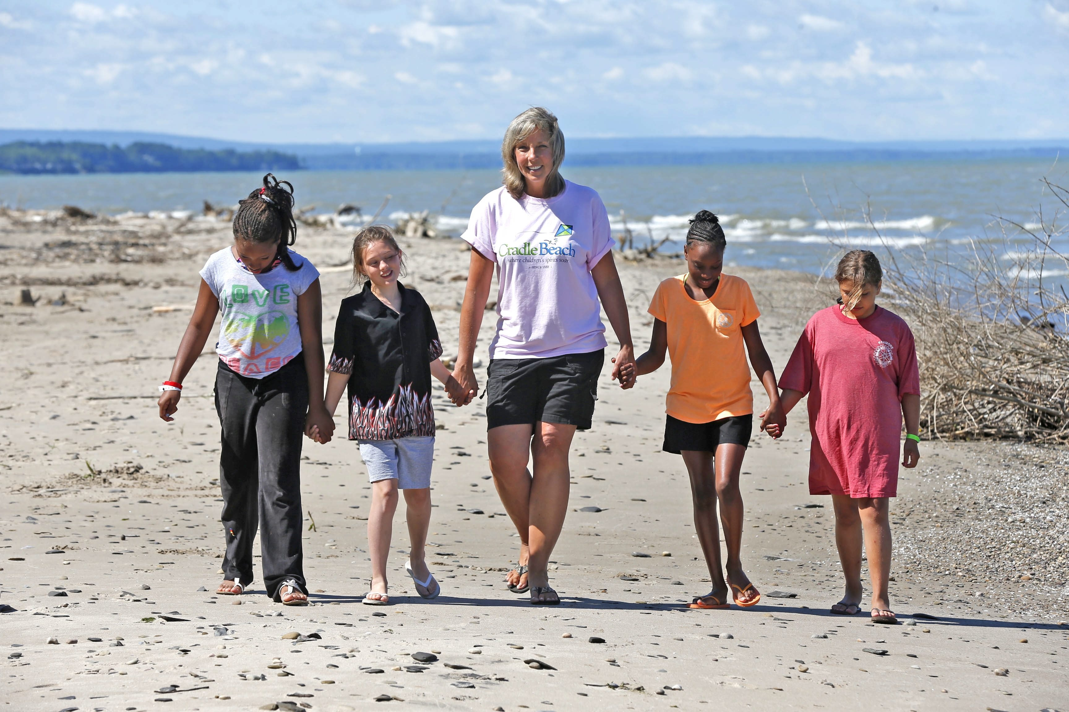 Lynn Kirshey, a special-ed coordinator at Niagara Charter School, helped raise money to send 15 Niagara Charter School students to Cradle Beach Camp this summer. Taking a walk with her are, from left, Diamond Davis-Hall, Jackie Phillips, Andrea Graham and Shyann Koziel.