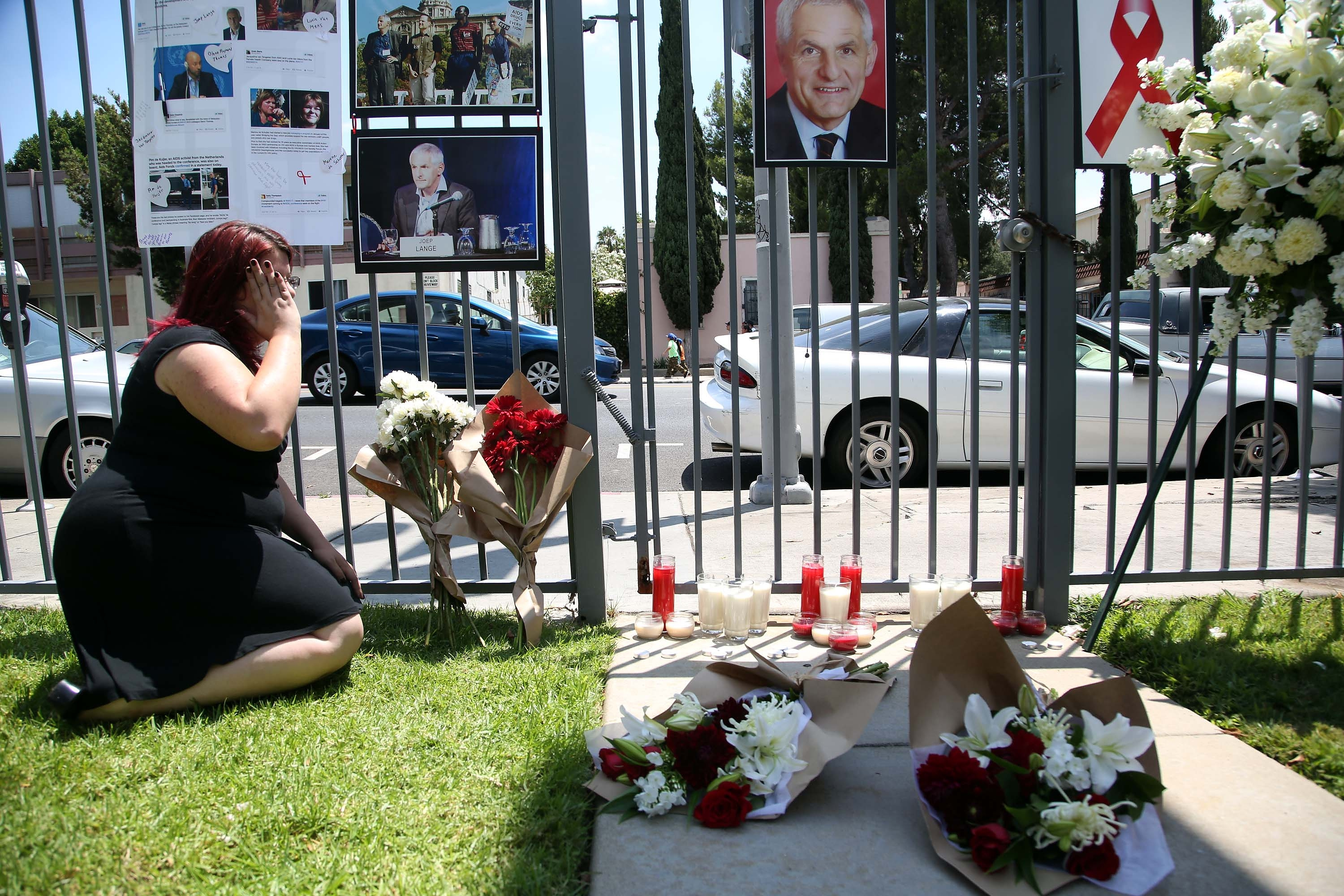 A woman in Los Angeles mourns the loss of Dr. Joep Lange, the former president of the International AIDS Society. The prominent researcher and others were headed to an AIDS conference in Australia when their Malaysia Airlines flight went down Thursday in Ukraine.