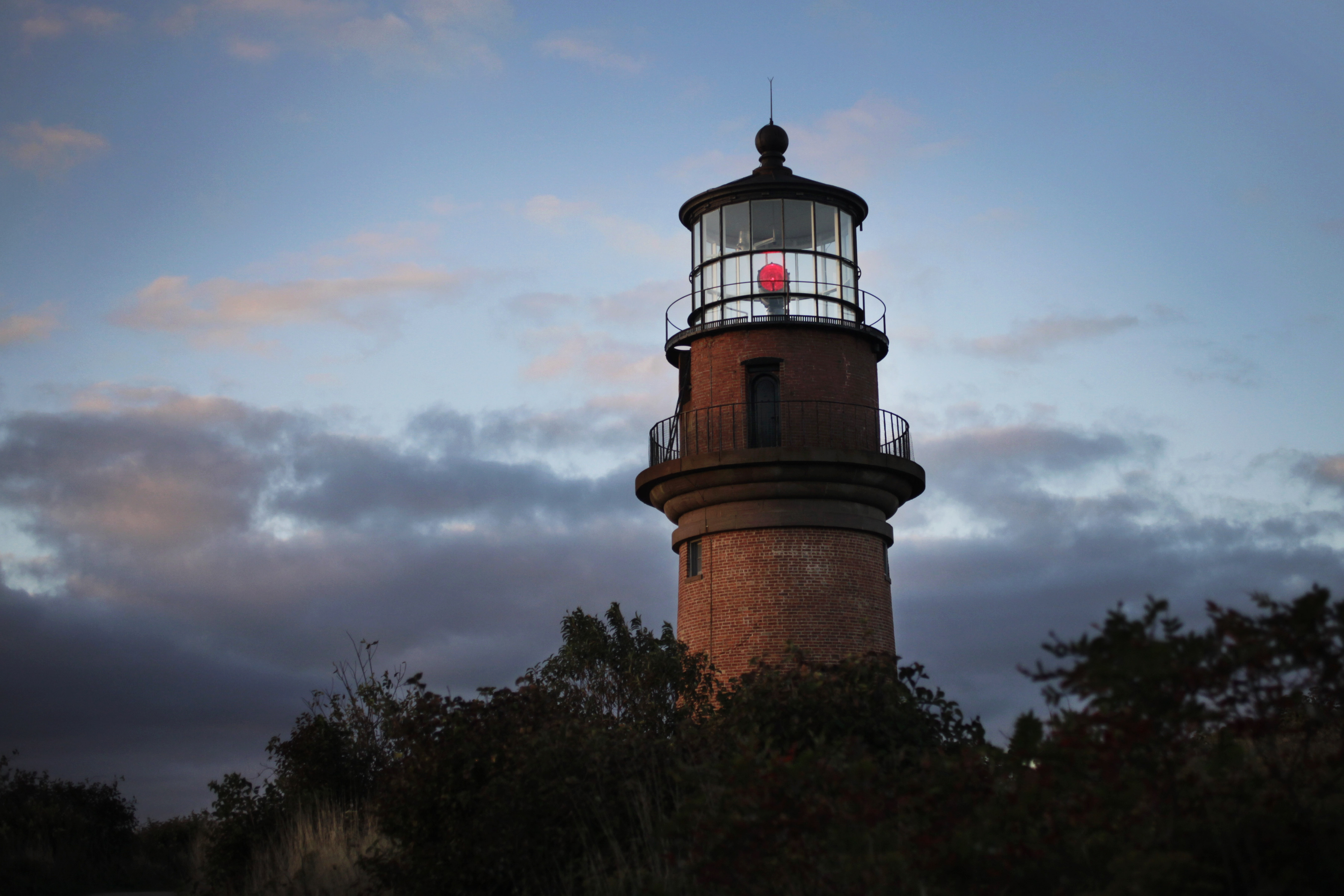 Gay Head Light flashes a red signal in Aquinnah, MA, Oct. 13, 2013 on the island of Martha's Vineyard. The lighthouse flashes alternating red and white beams of light. (AP Photo/Mark Lennihan)