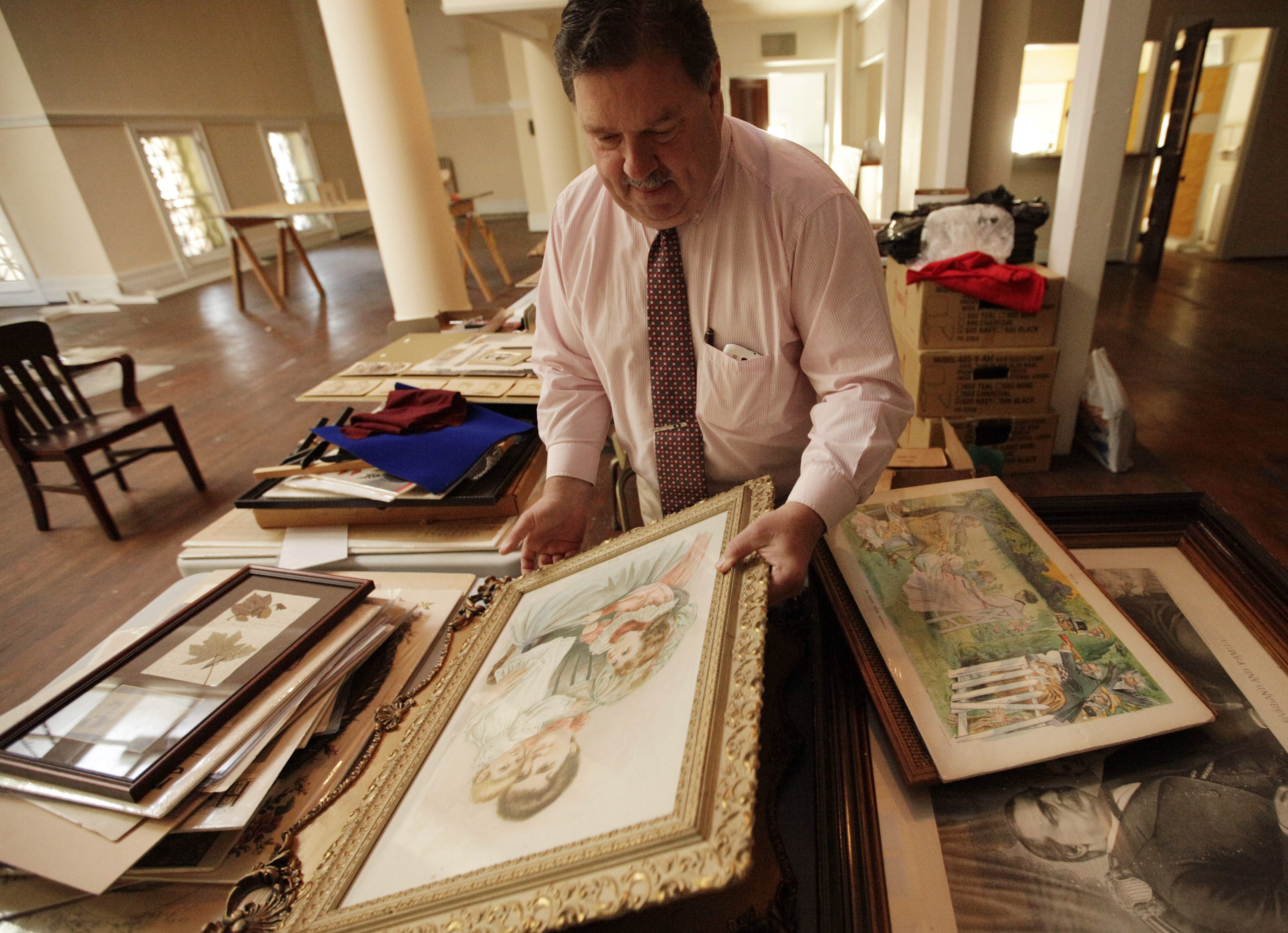 Historian Mark D. Evans sorts through some of his nearly 600 pieces of Frances Folsom Cleveland memorabilia as he prepares for a new exhibit in the Robert H. Jackson Federal Courthouse.