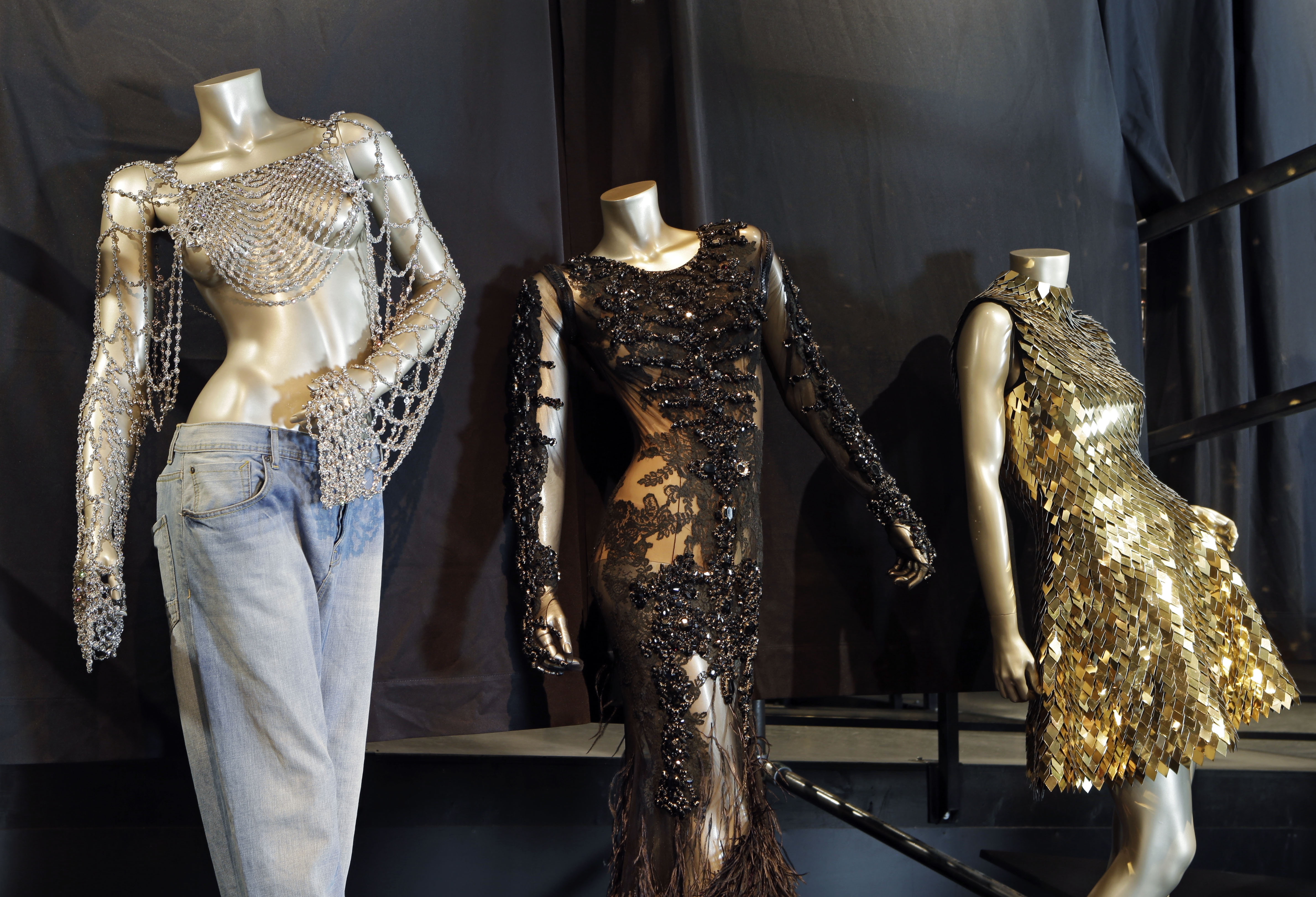 """Outfits from Beyoncé's 2003 """"Dangerously in Love,"""" and 2012 Met Gala are shown in a new exhibit at the Rock and Roll Hall of Fame in Cleveland."""