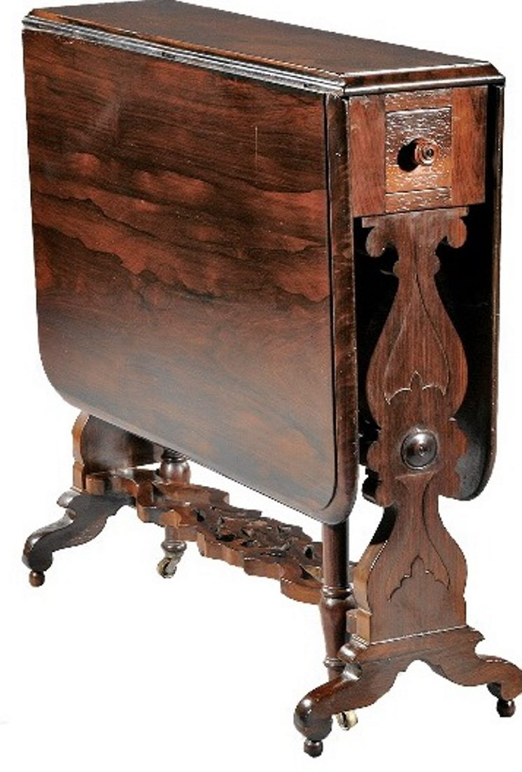 J. and J.W. Meeks of New York City made this classical drop-leaf table about 1840. It has a stenciled label in the drawer with the address of the workshop from 1836 to 1855. It extends to 45 inches long. The table sold for $1,075 in New Orleans.