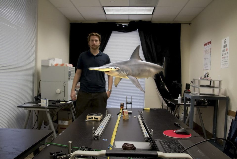 Motion sickness has long been the Achilles' heel of nascent virtual reality platforms, a problem that Magic Leap believes it can bypass. Using digital light field technology, it seamlessly places an image of a swimming shark in an office setting.