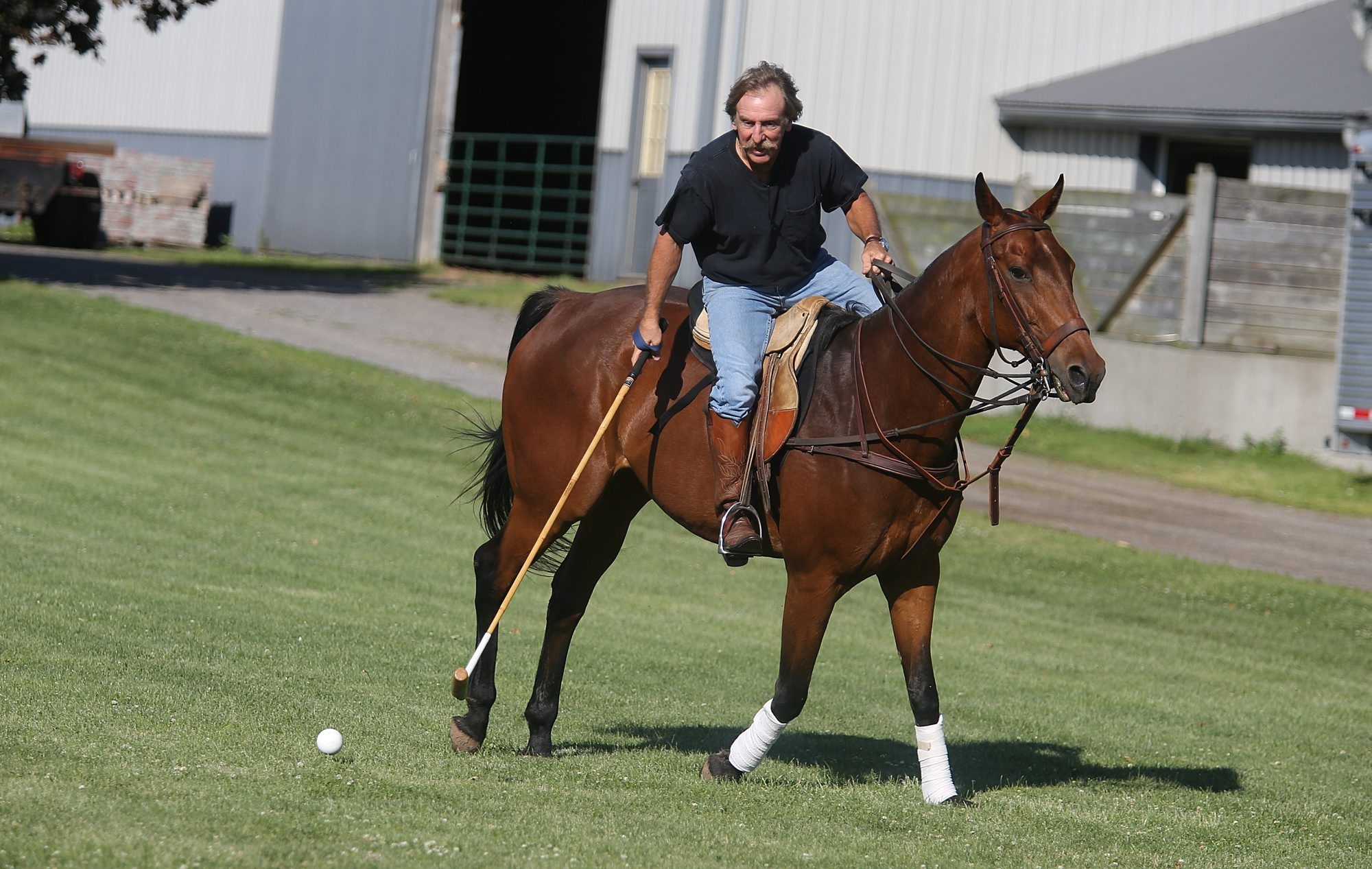 Slade Sharpsteen practices polo moves with his polo horse Squirt on his Town of Cambria farm.